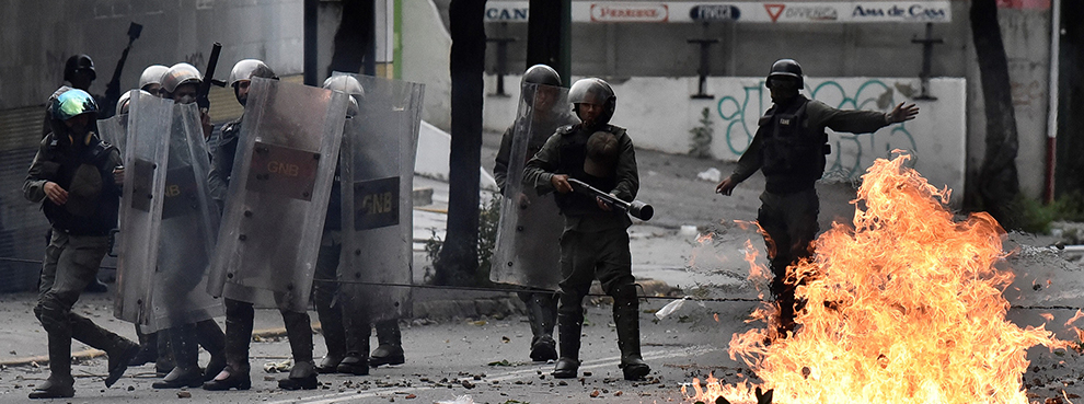 Members of the Bolivarian National Guard clash with anti-government protesters in Caracas, Venezuela on July 20, 2017 (Carlos Becerra/Anadolu Agency/Getty Images)
