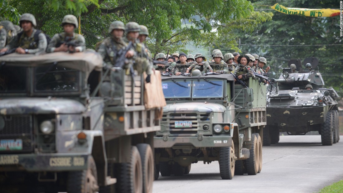 Philippine marines aboard their vehicles maneuver through a street on their way to an assault on the hide out of Muslim militants near the town center in Marawi, in southern island of Mindanao on May 28, 2017.