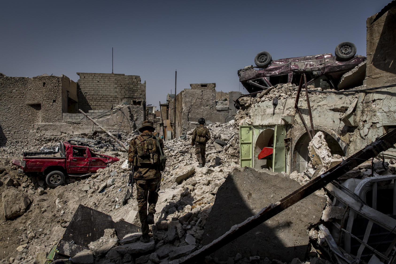 Iraqi special forces soldiers search houses for explosives and any remaining Islamic State fighters in a destroyed section of the Old City of Mosul, Iraq, July 23, 2017. Photo courtesy of Ivor Prickett/The New York Times.