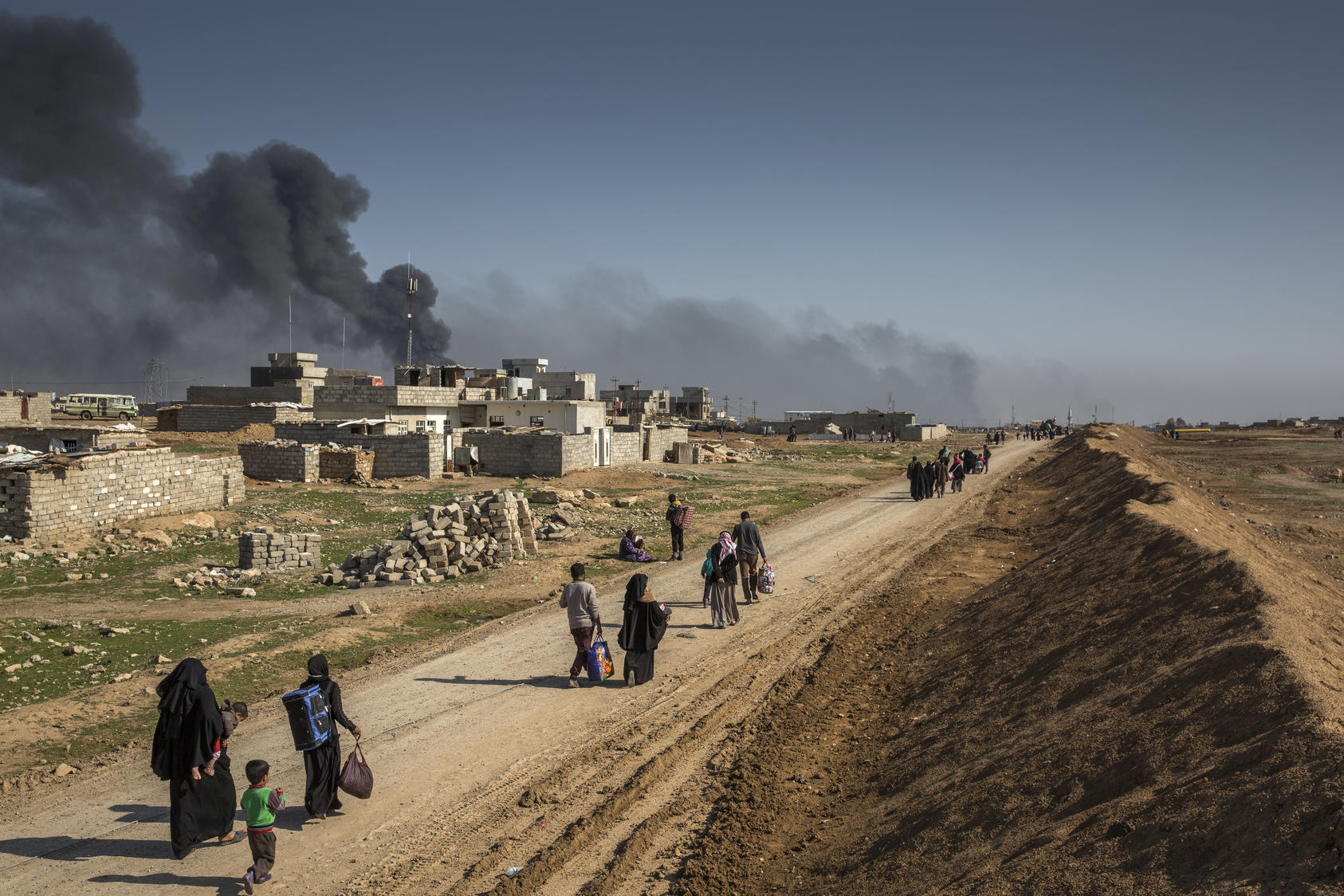 People flee the fighting between Iraqi security forces and Islamic State militants in Mosul, Iraq. Photo courtesy of Ivor Prickett/The New York Times.