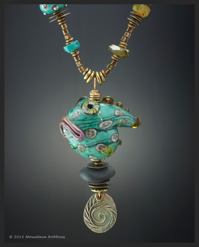 Teal Grumpy Grouper. Mixed-media necklace featuring lampwork glass beads and metal charms created by Wayne Robbins and Judie Mountain.