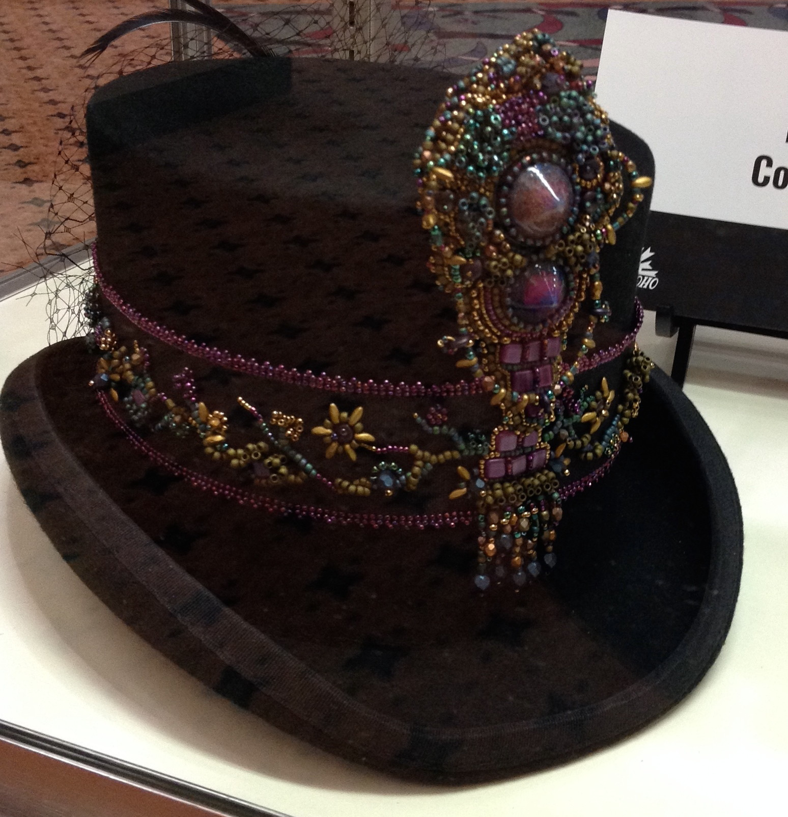 The embellishment on this top hat was created by Kathy Cosgrove.