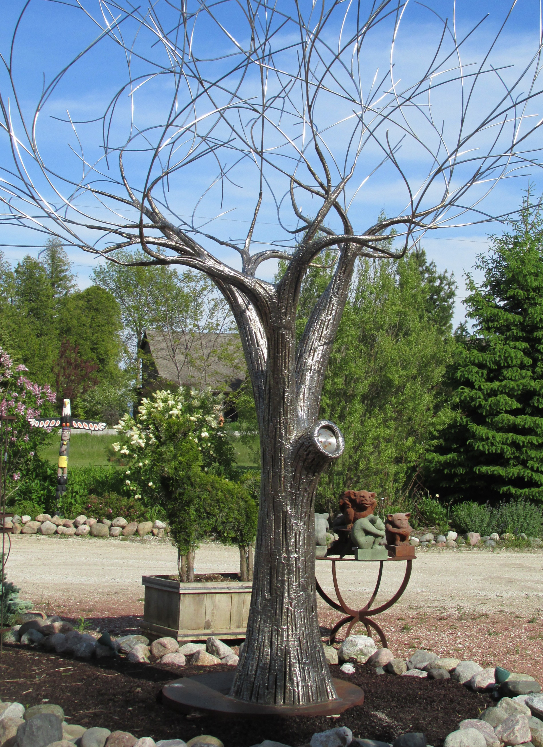 Very well done full size metal tree sculpture. I'll bet this piece even looks good in the winter with the snow!