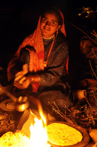 Appa makes chapattis before breaking camp