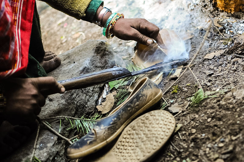 Patching shoes with pieces of other shoes, using a searing hot blade