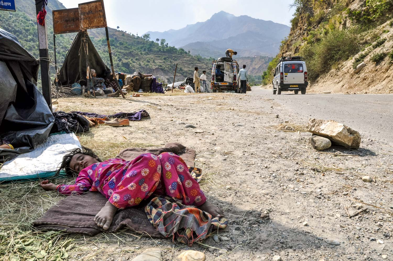 Salma naps at the camp outside Bornigad.
