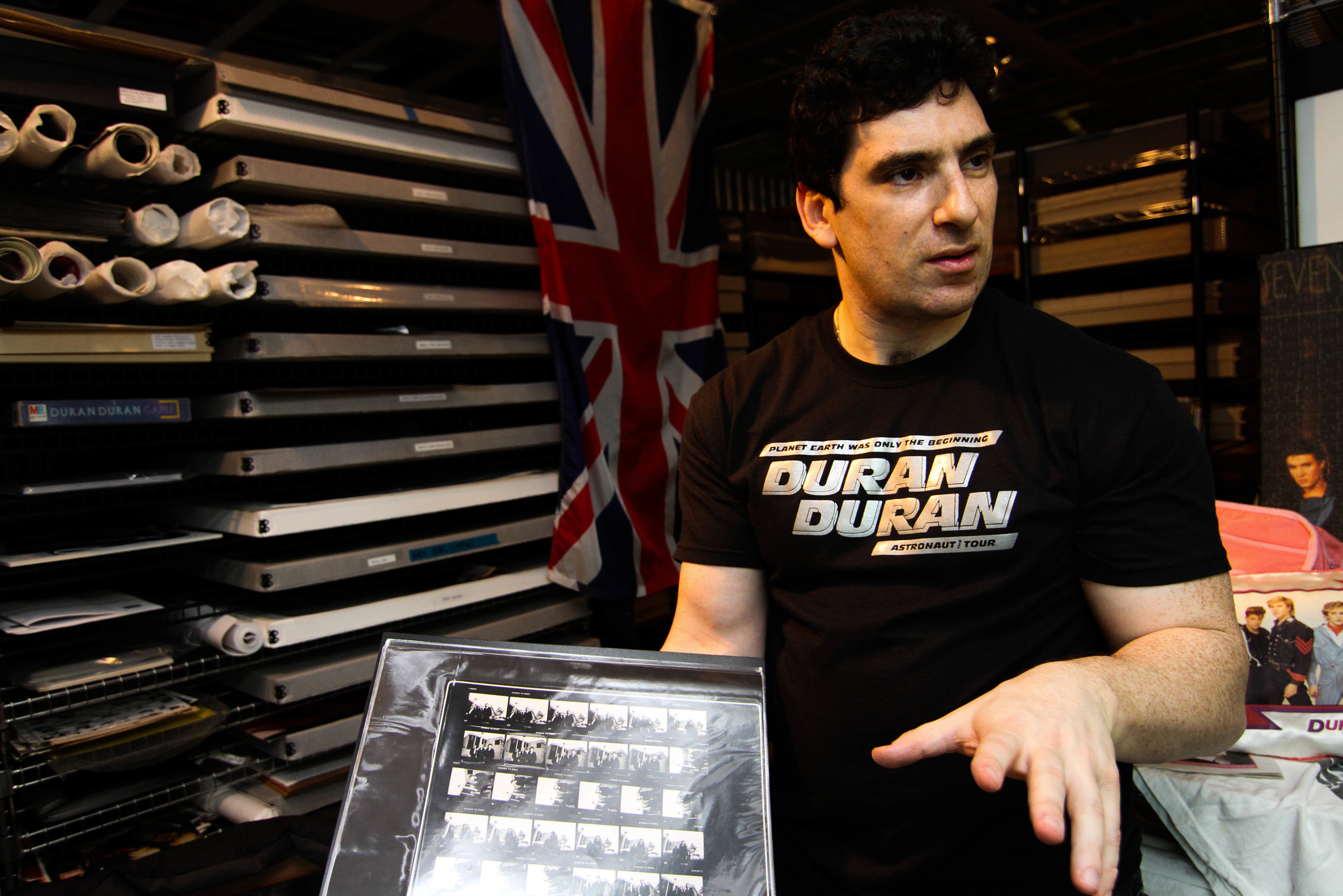 """Andrew """"Durandy"""" Golub, 42, shows rare film negatives that are a part of his Duran Duran collection on Saturday afternoon, April 5, 2014. Golub has become a well-known archivist of Duran Duran memorabilia. He houses his in a storage unit in Bellevue, Wash."""