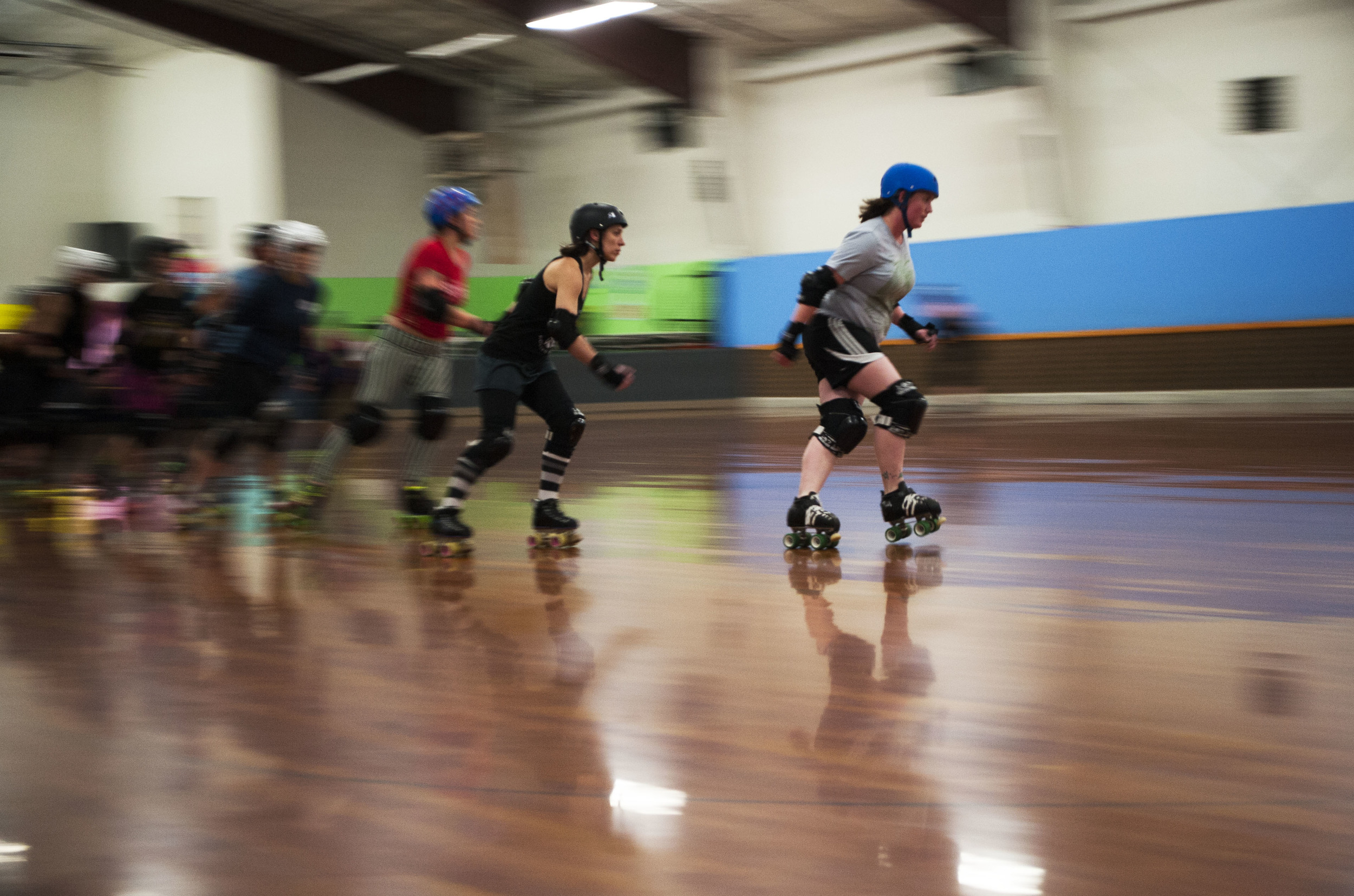 """The squeal of skates skidding along the polished wood floor reverberates throughout the skating rink. For Bellingham's Roller Betties this is a familiar sound. The Betties are a roller derby league comprised of six unique teams, all found on their website. Three days a week they don their skates and speed out on to the rink to practice and learn skills that will help them beat their opponents during their next bout.""""You've got to be really on top of your physical fitness,"""" says Kimberly """"Kim Carnage"""" Carnahan (right). """"It's battle ballet. It's like, plié, now hit somebody."""""""