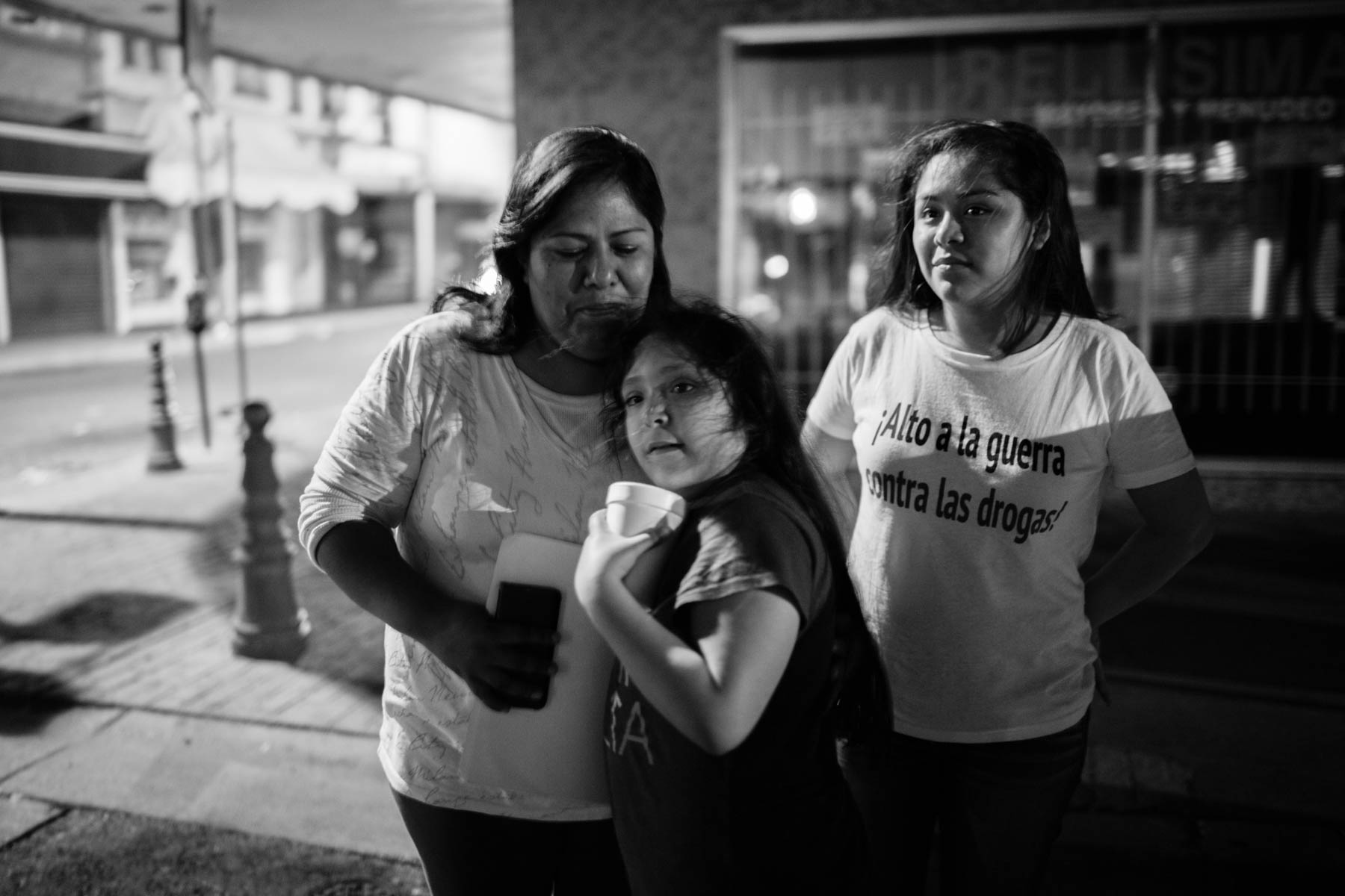 14 April 2016 - Loredo, Texas - Myrna Lazcano, Michel Animas Lazcano, Heidy Animas Lazcano (f.l.t.r.) after their reunifcation in Loredo. The children have been seperated from their mother after she was deported to Mexico three years ago in 2013. In 2012 200'000 parents have been separted from their US-citizen children through deportation like in the case of the family Lazcano.  Photo credit: Cédric Dürig