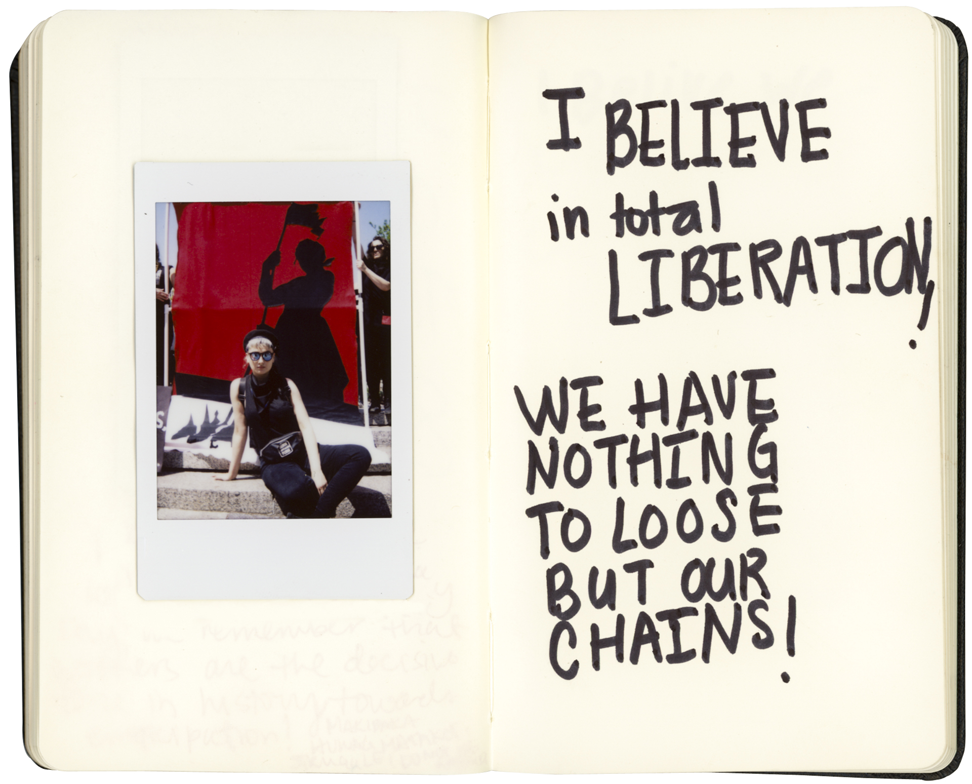 """01 May 2017 - Union Square, New York - May DayElektra KB, Brooklyn, artist""""I believe in total liberation! We Have nothing to loose but our chains!""""Credit: Cédric von NiederhäusernINFO:Notebook digitally altered to fit layout dimensions"""