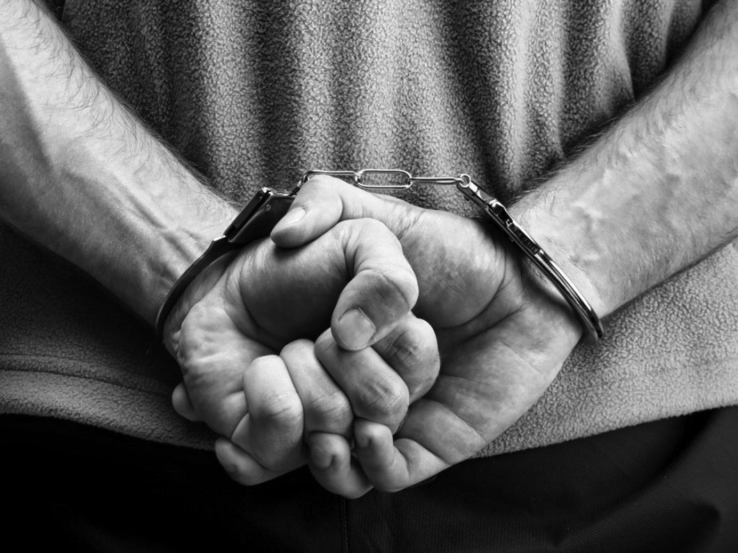 bigstock-Criminal-In-Handcuffs-14611325.jpg