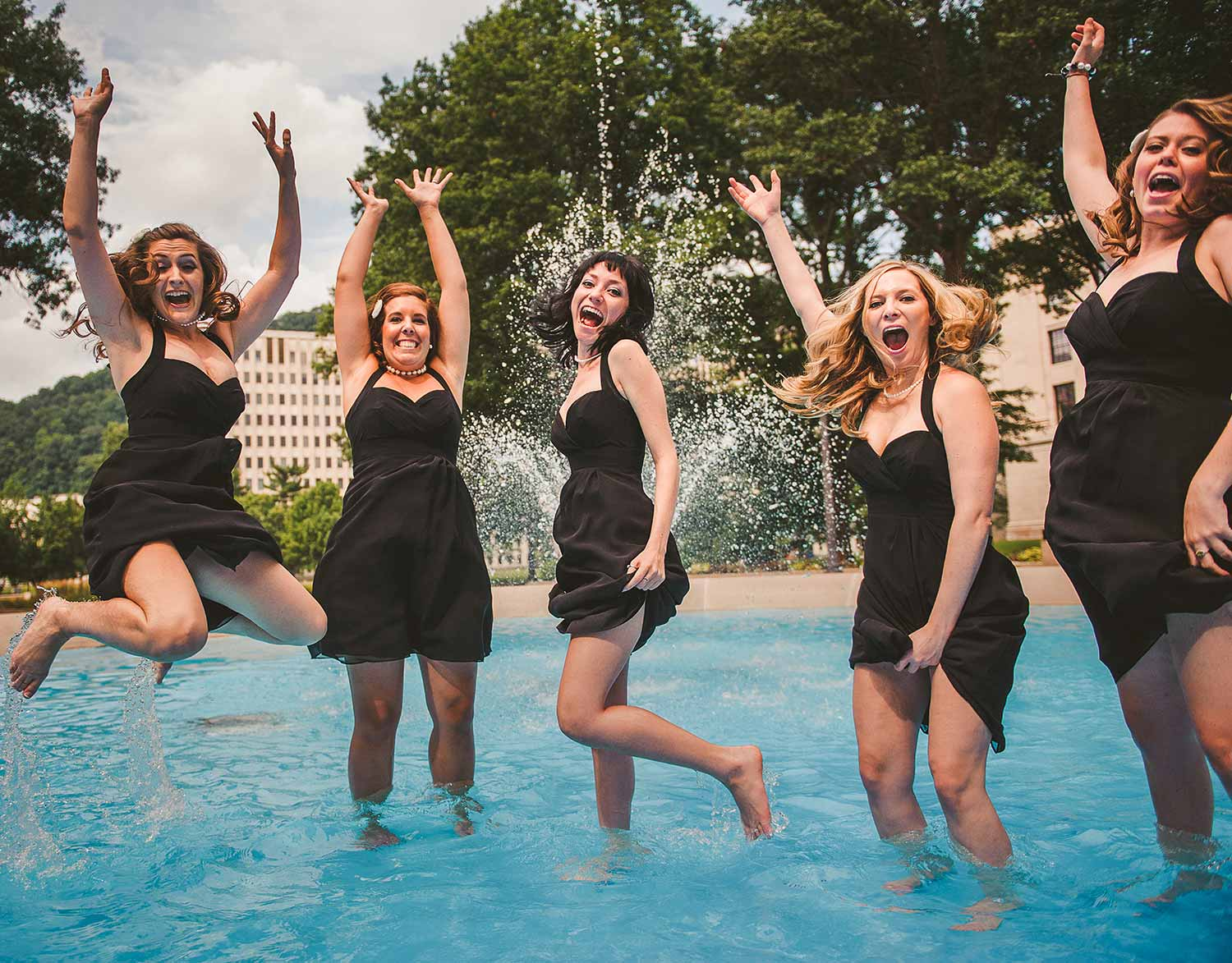 charleston-west-virginia-statehouse-funny-bridal-party-in-fountain.jpg