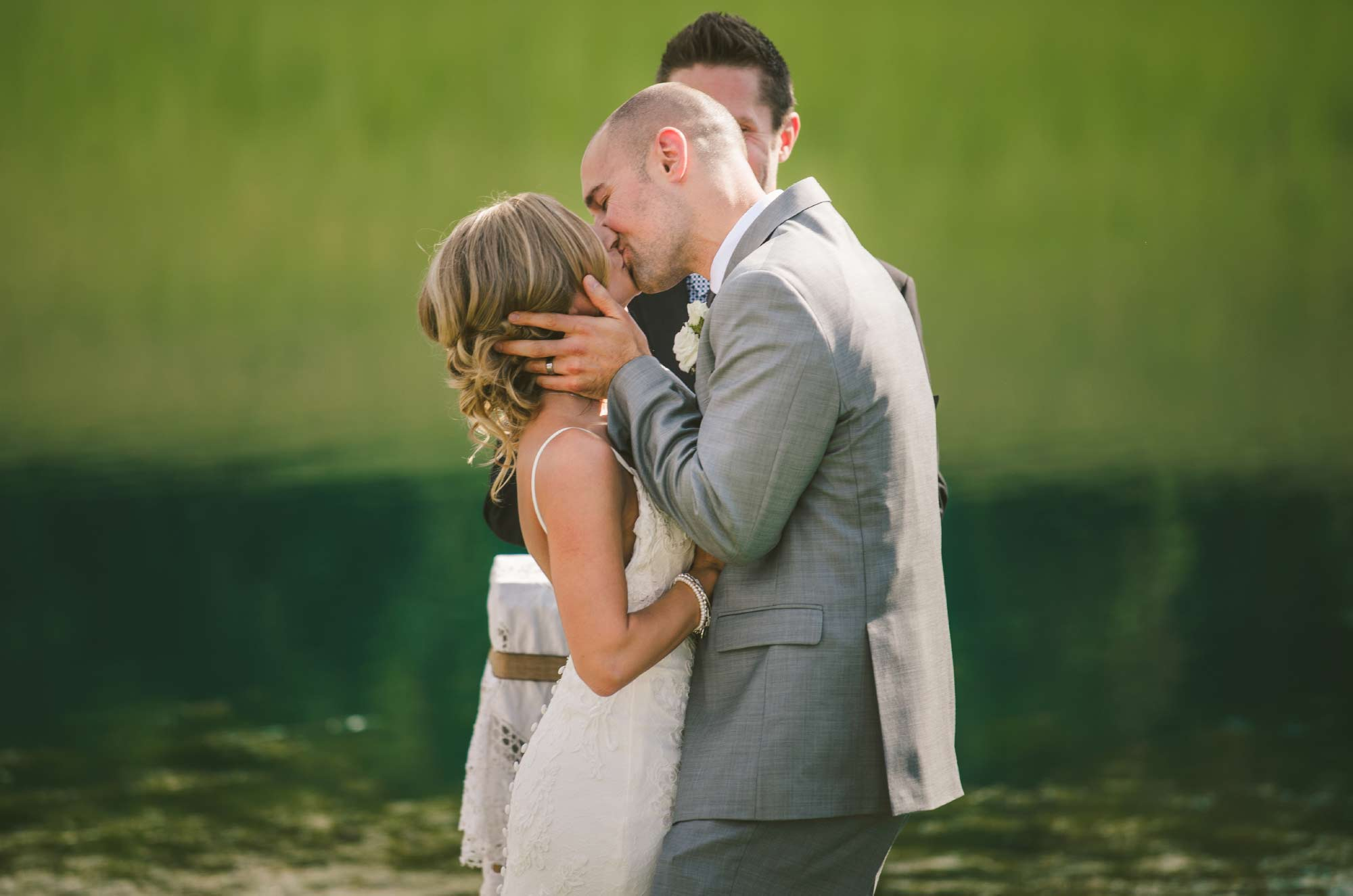 The kiss bride and groom wedding ceremony