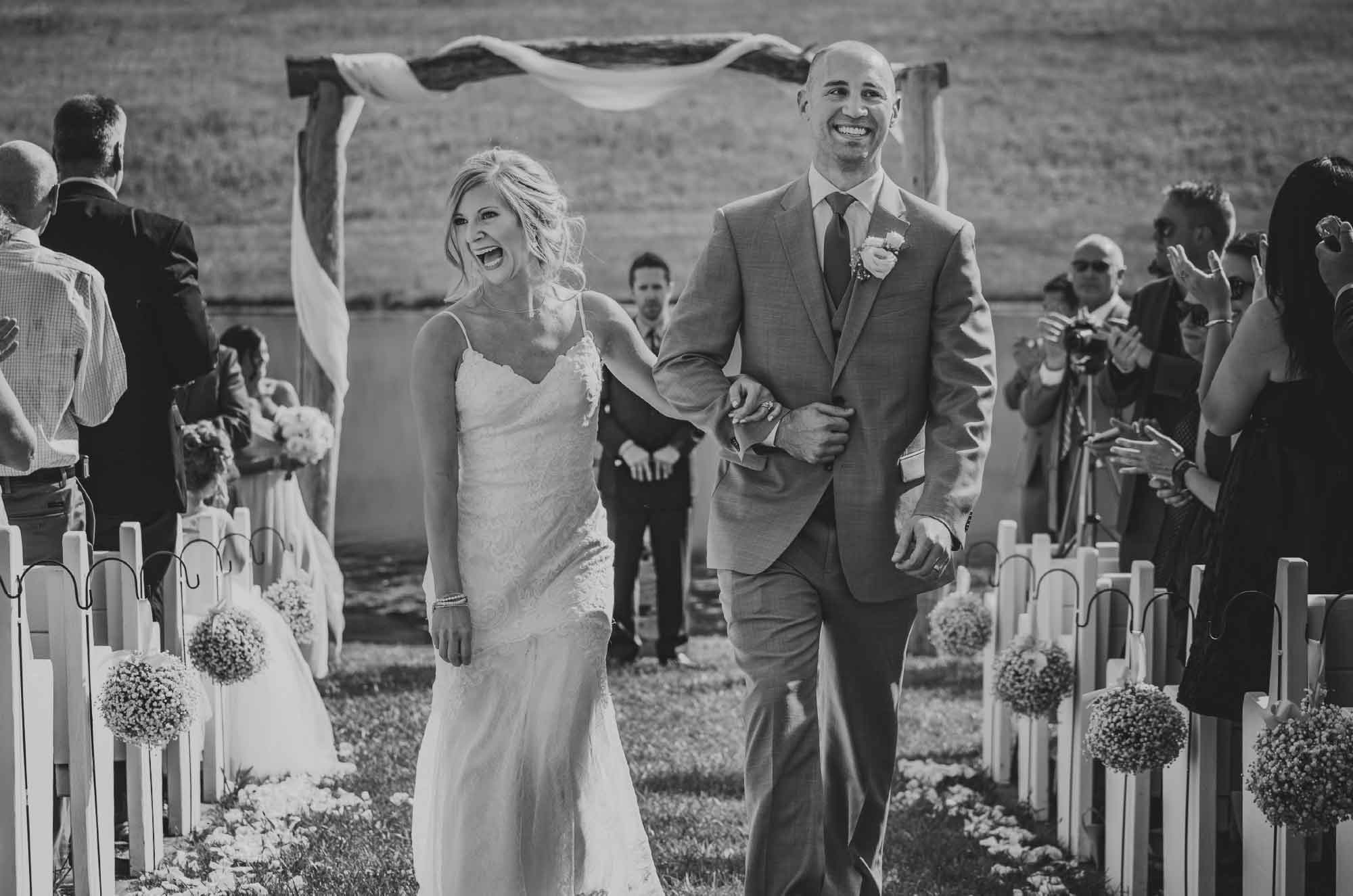 Bride and groom walking up the aisle wedding recessional
