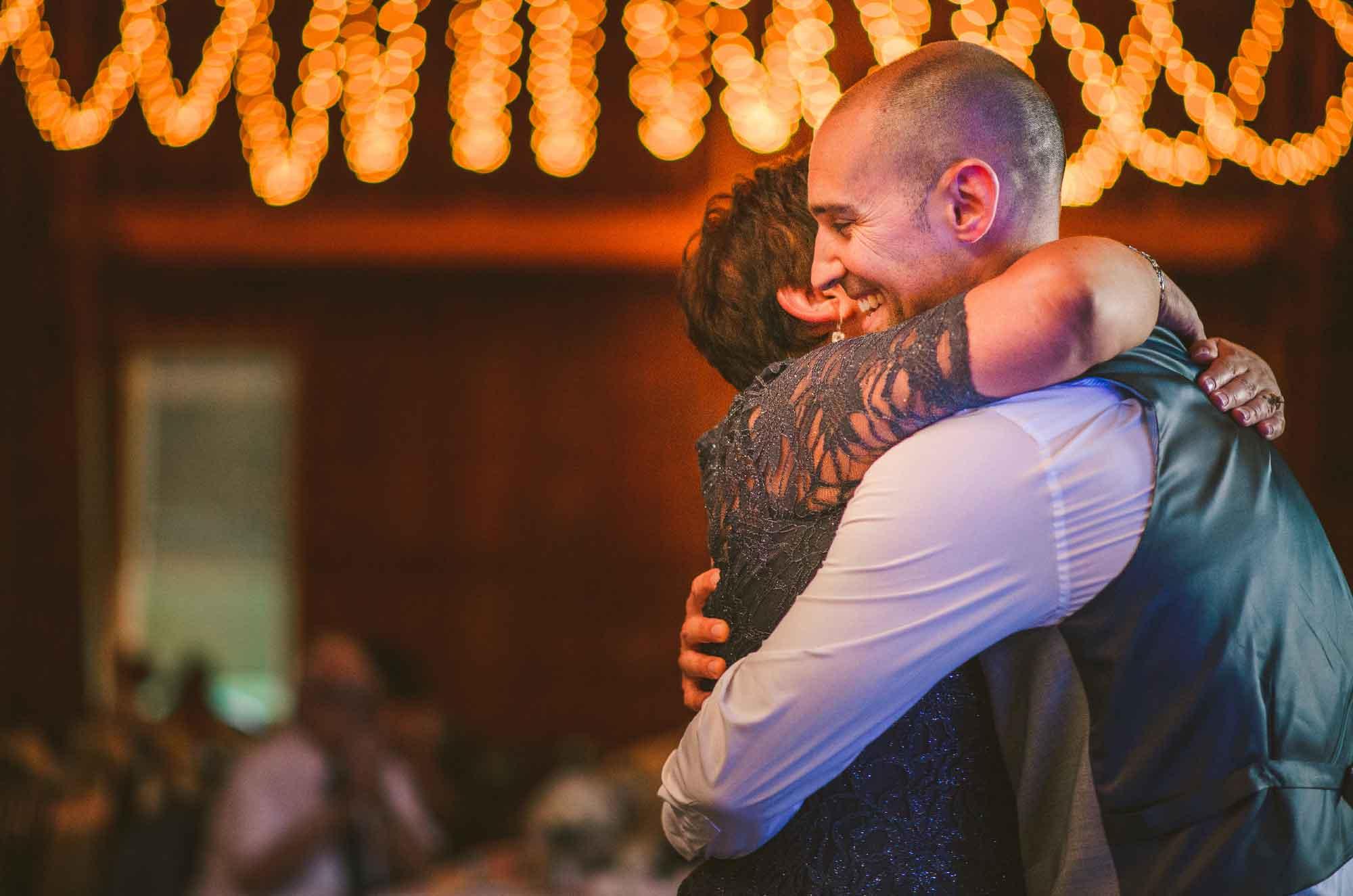 29-wedding-reception-mother-son-hug.jpg