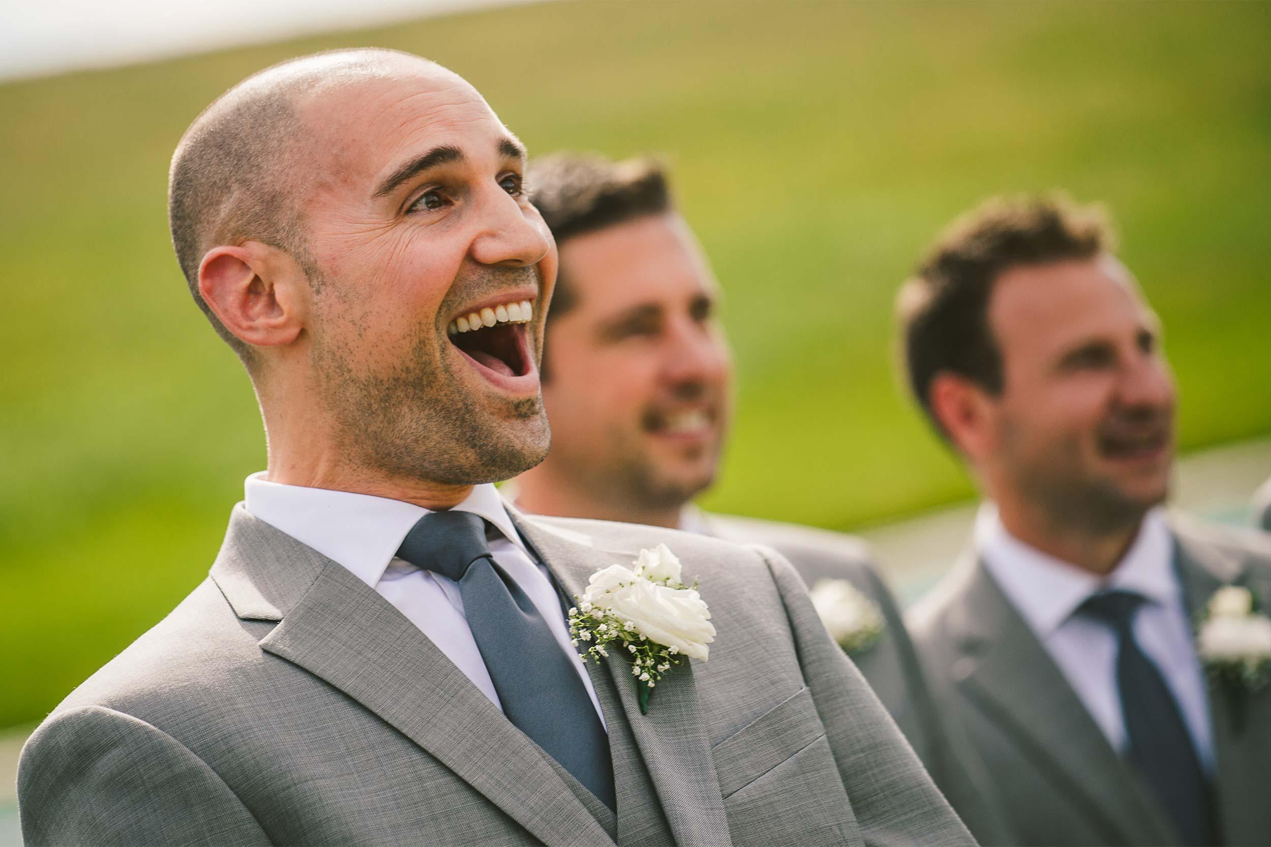 groom-surprised-first-look-wedding-ceremony.jpg
