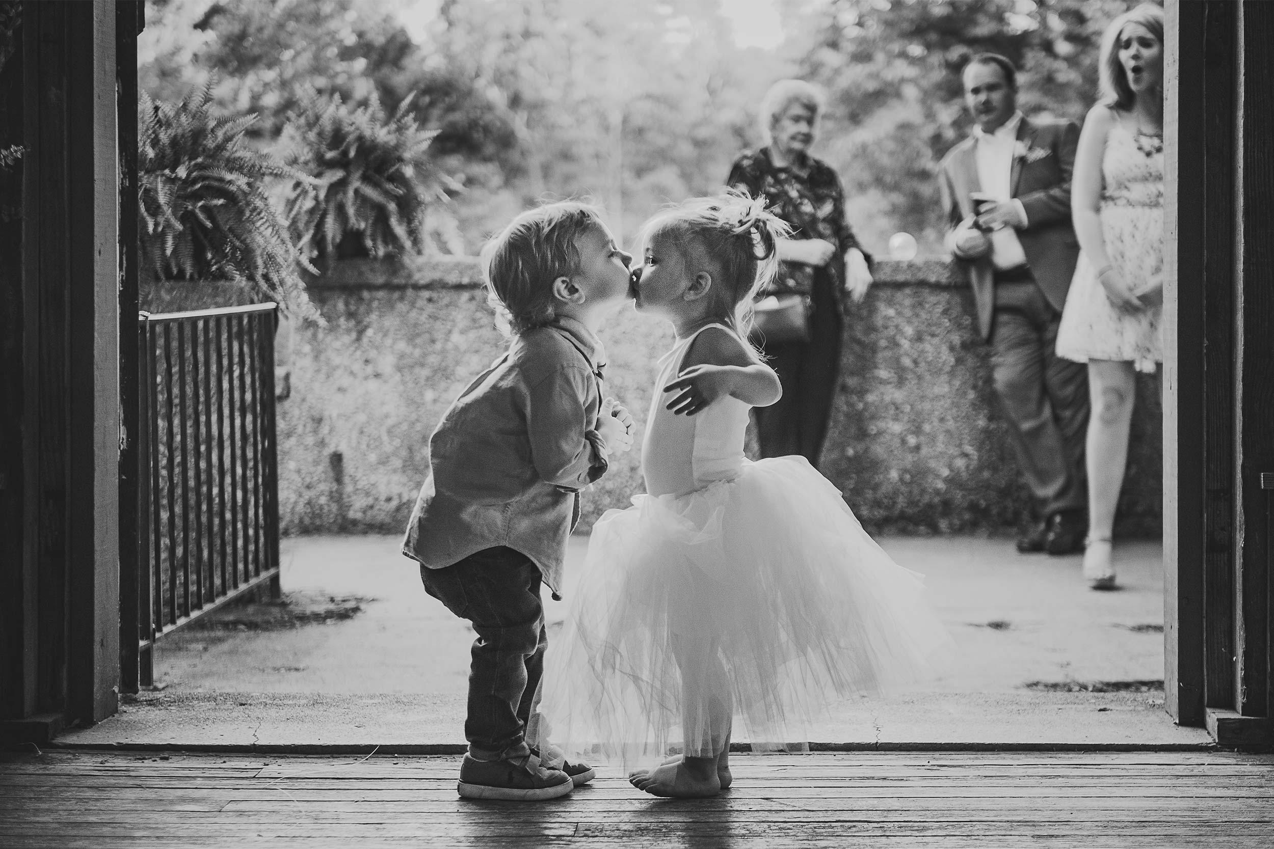 sweet-candid-flower-girl-kiss.jpg