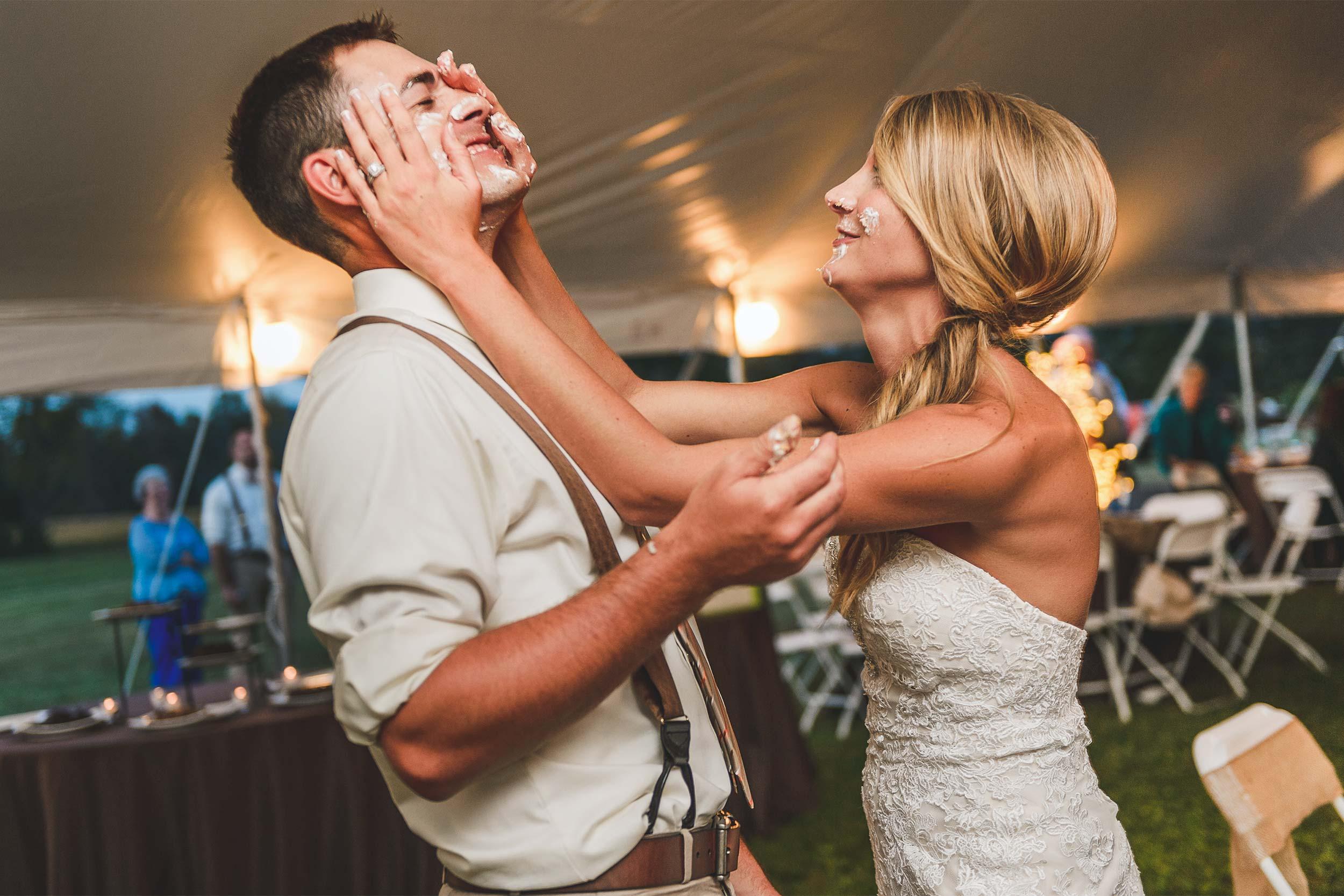 tent-wedding-reception-cake-smash.jpg