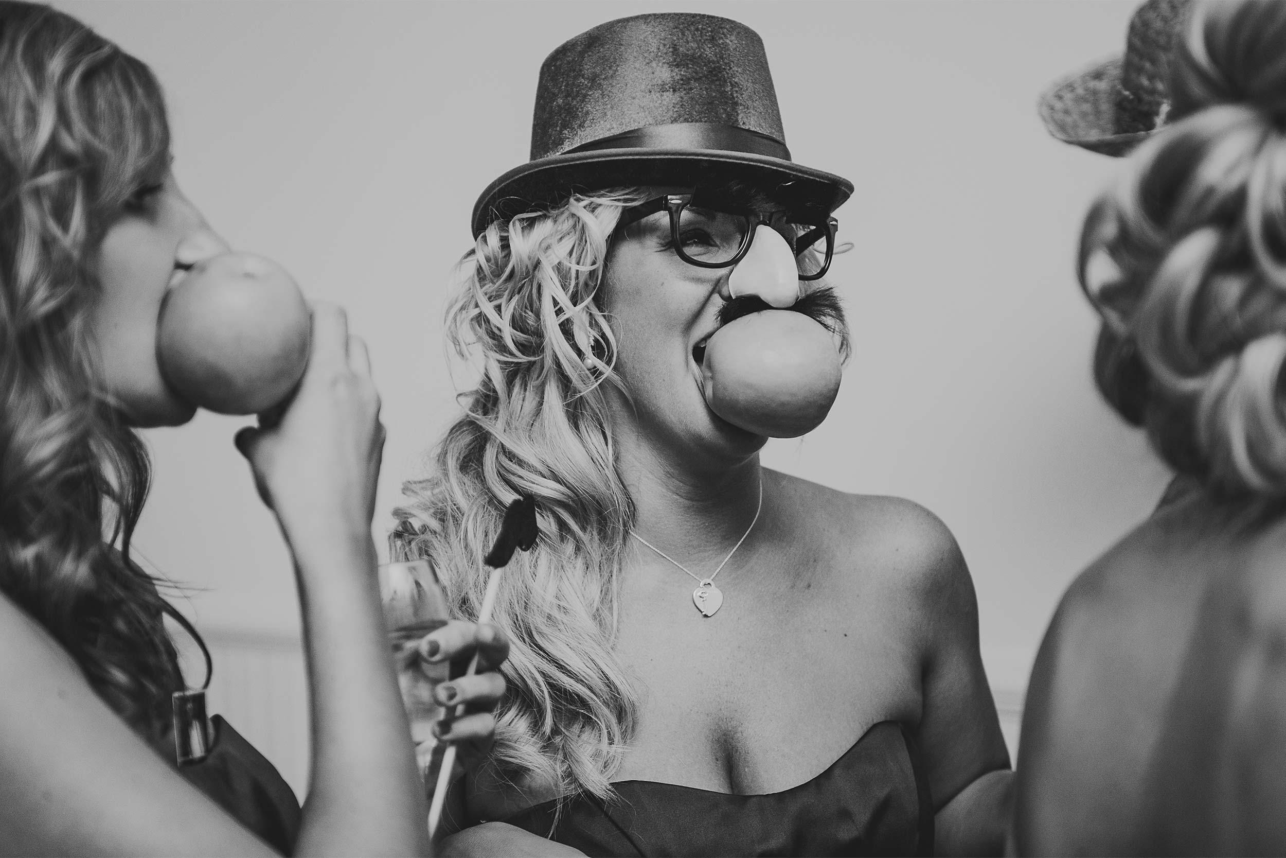 wedding-reception-candid-bridesmaids-mask.jpg