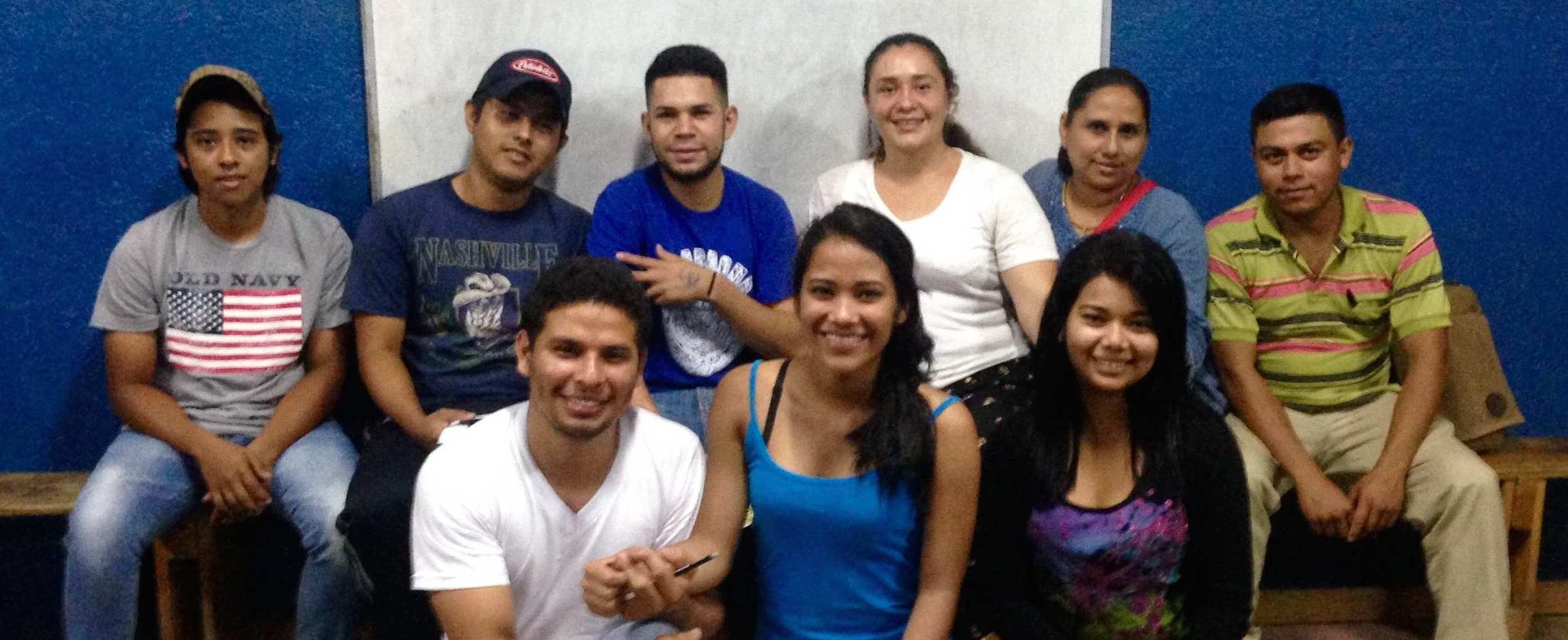 Estela (back row, fourth from left) and classmates on the first day of English Vocational Training.