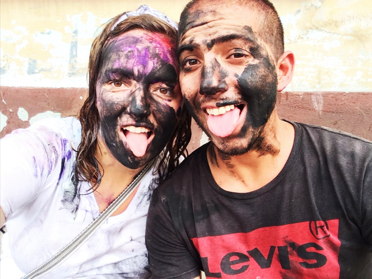 """In Ecuador, locals celebrate the Carnival holiday by taking to the streets and """"playing,"""" spraying each other with water, throwing eggs, flour, and colored dies, and playing with small fire extinguisher-like canisters that spray foam everywhere!"""