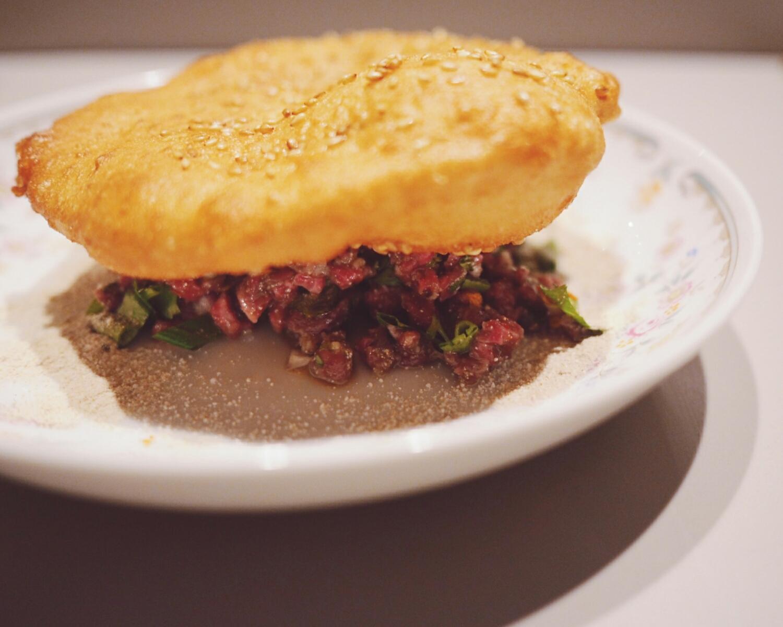beef tartare withlarb seasoning, sesame bread.