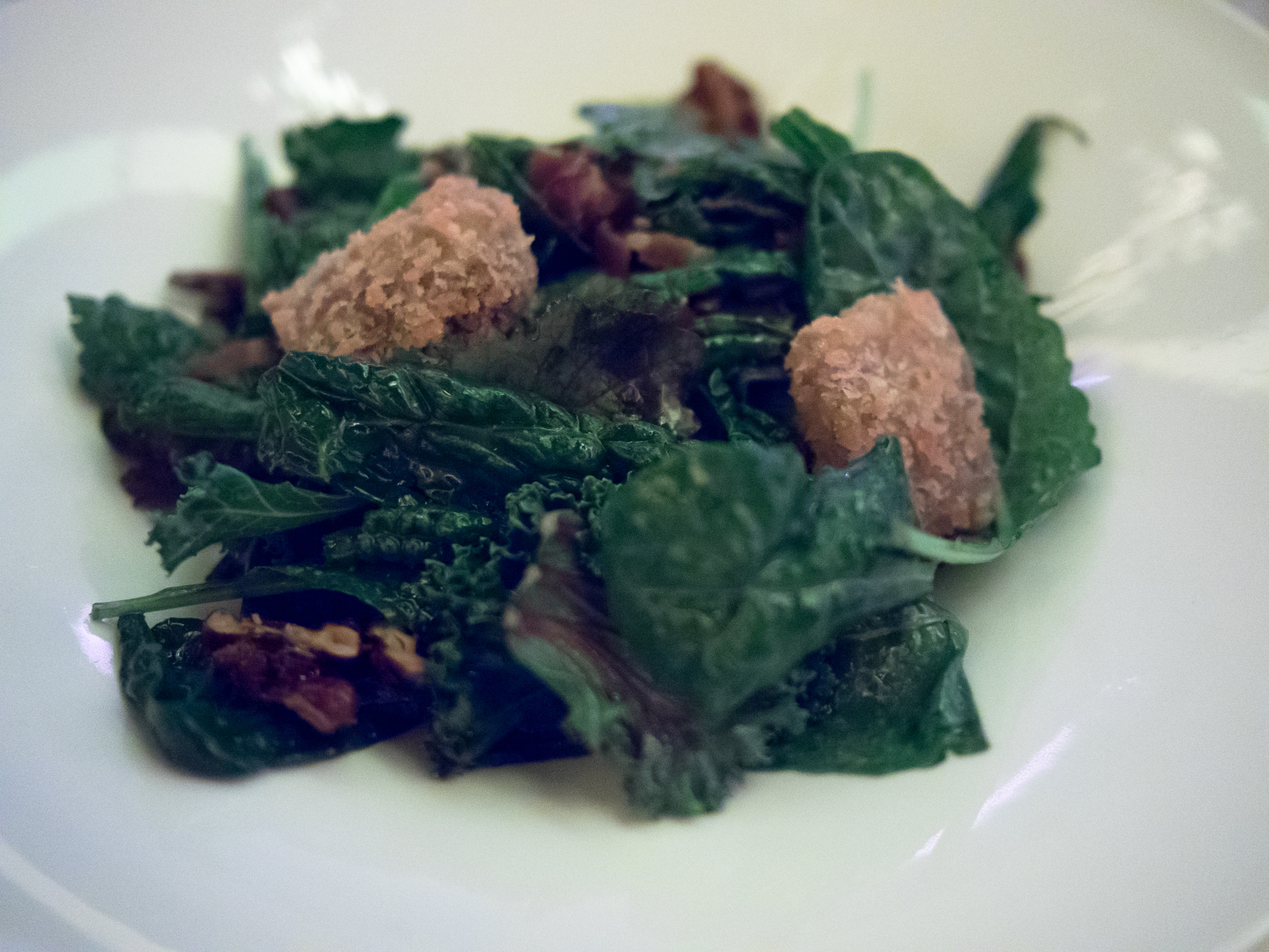 warm kale salad  with smoked bacon, dates, crips brie, walnuts.