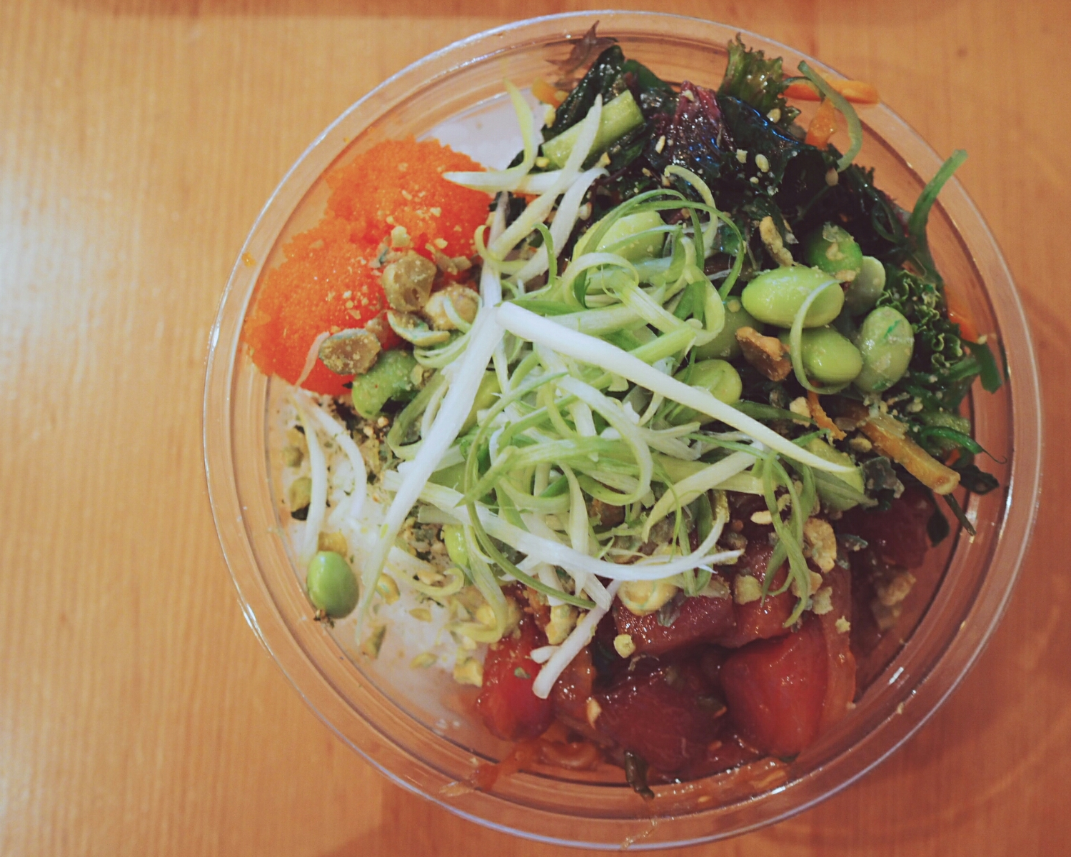 the ohana shoyu over white rice with seaweed salad and masago.