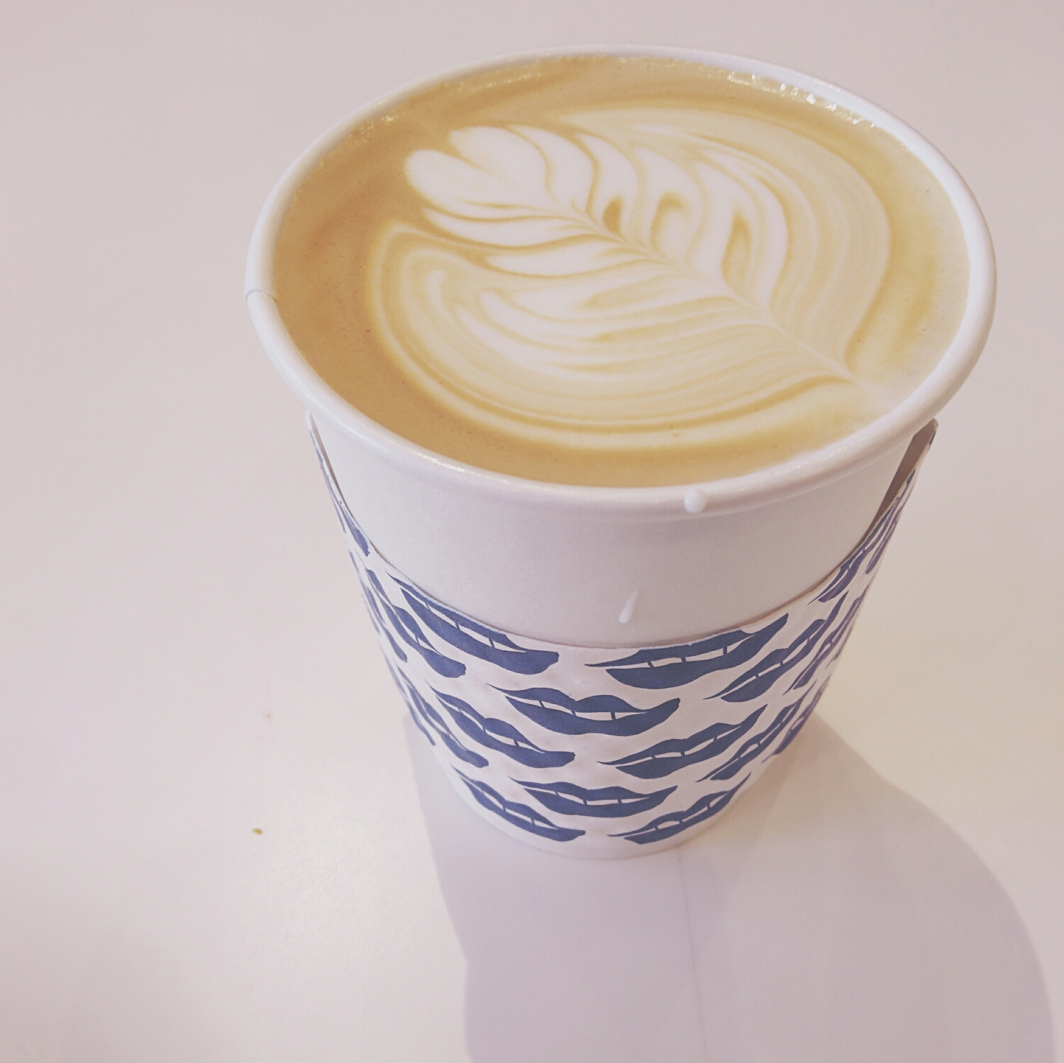 expertly poured latte.