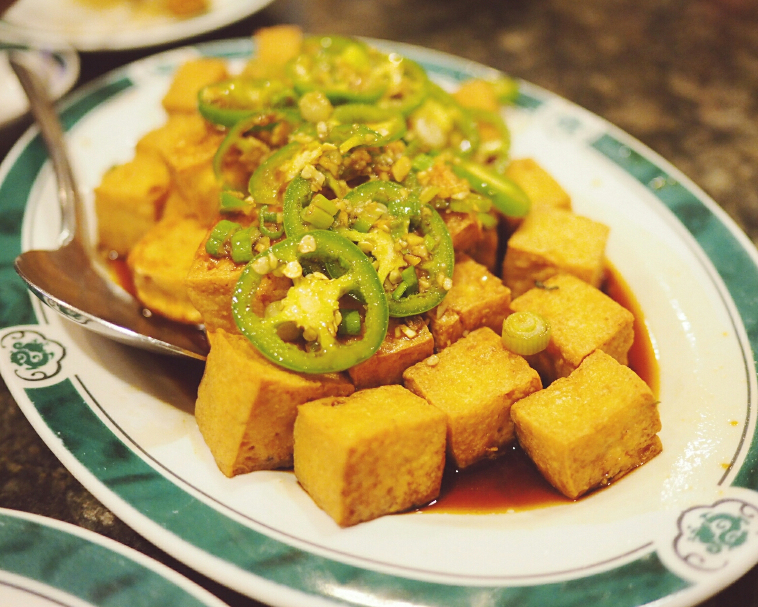 fried tofu with jalapeno, scallions, garlic.