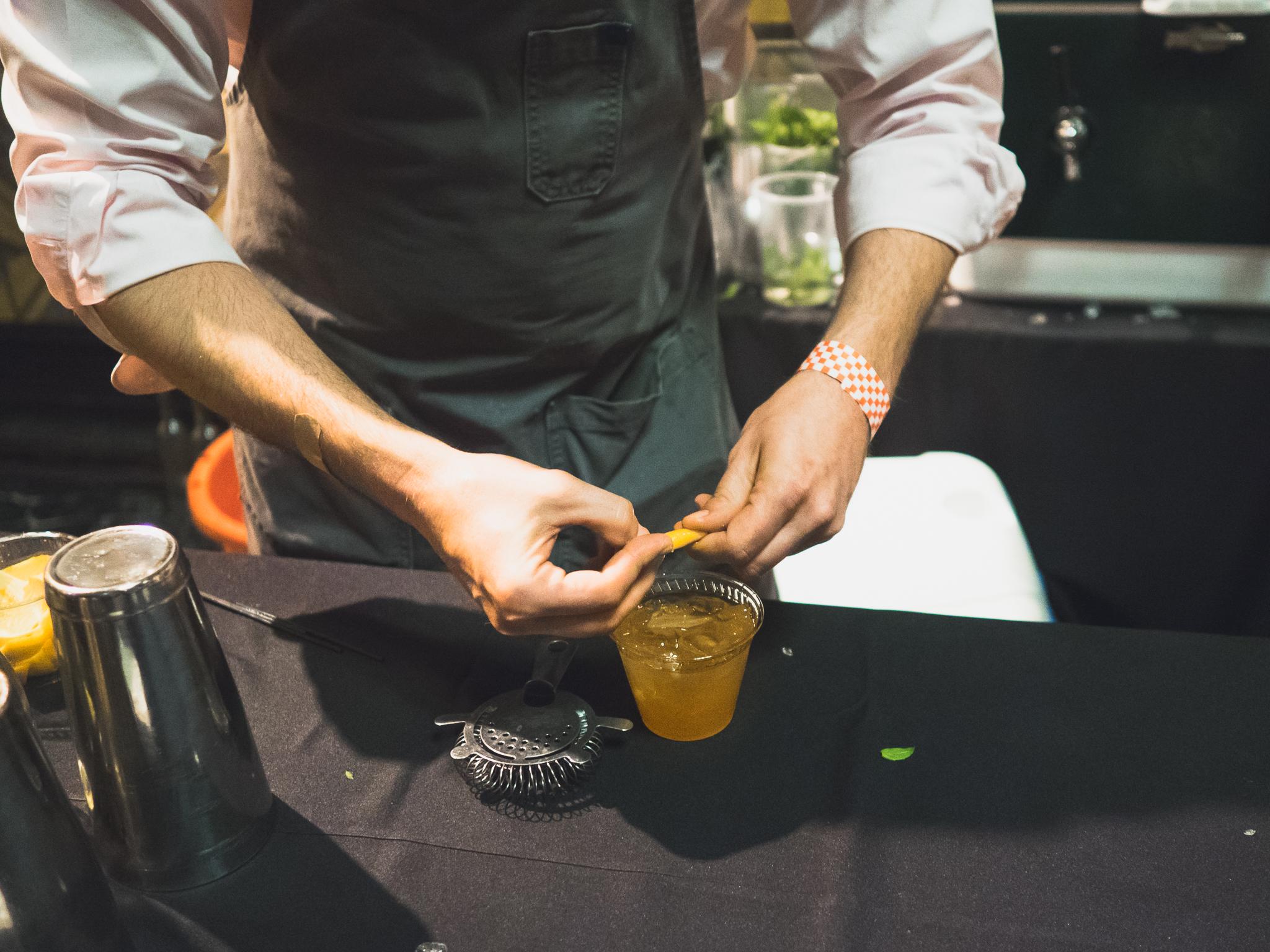 an orange twist for the  cardinal punch  (buffalo trace bourbon, lustau brandy, grand poppy bitters, roasted orange, clove, champagne, lemon orange essence).
