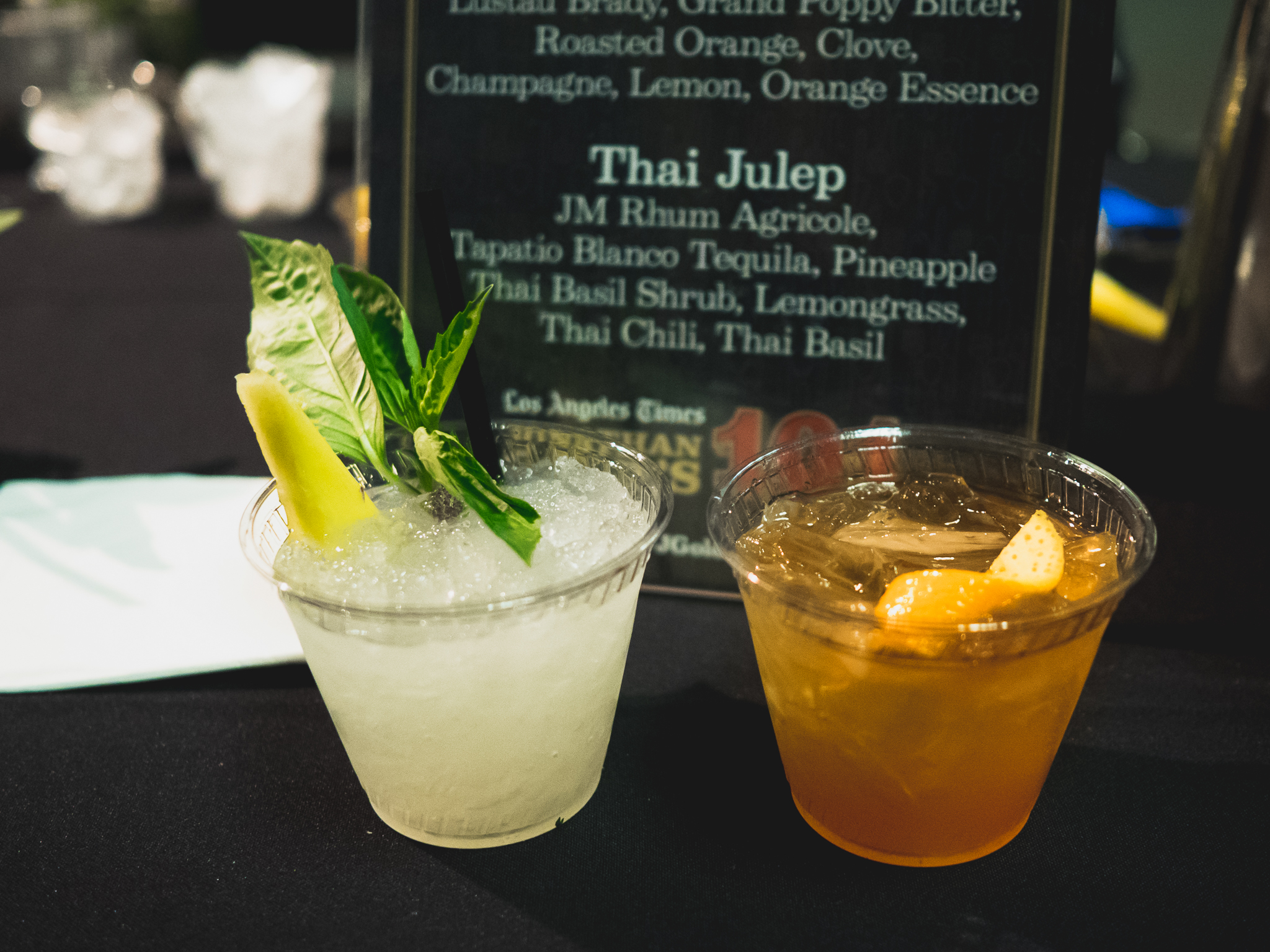 redbird's  thai julep  (jm rhum agricole, arette blanco tequila, pineapple thai basil shrub, lemongrass, thai chili, thai basil) and cardinal punch.