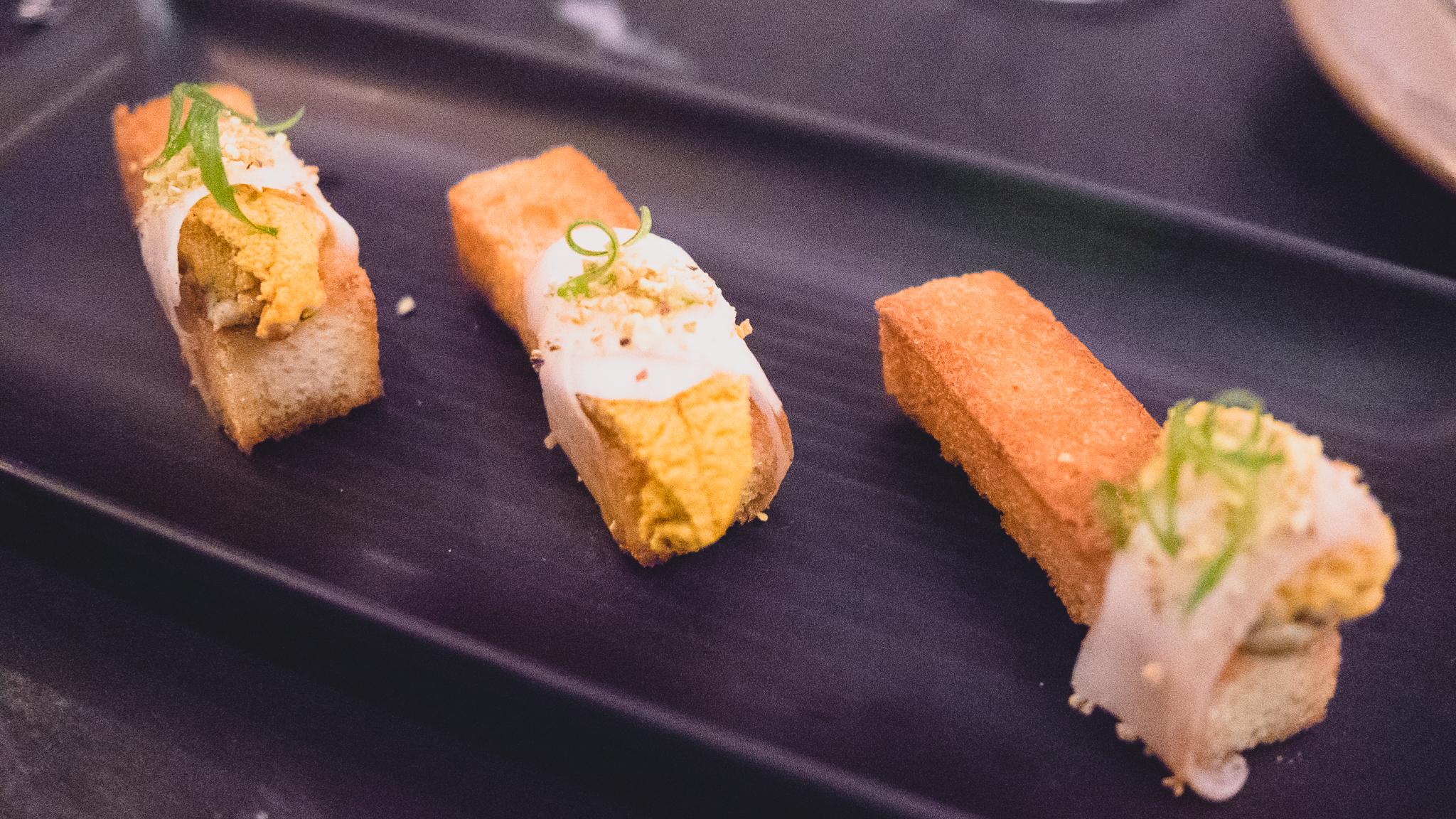 sea urchin  on brioche with lardo, pistachio and truffle butter.