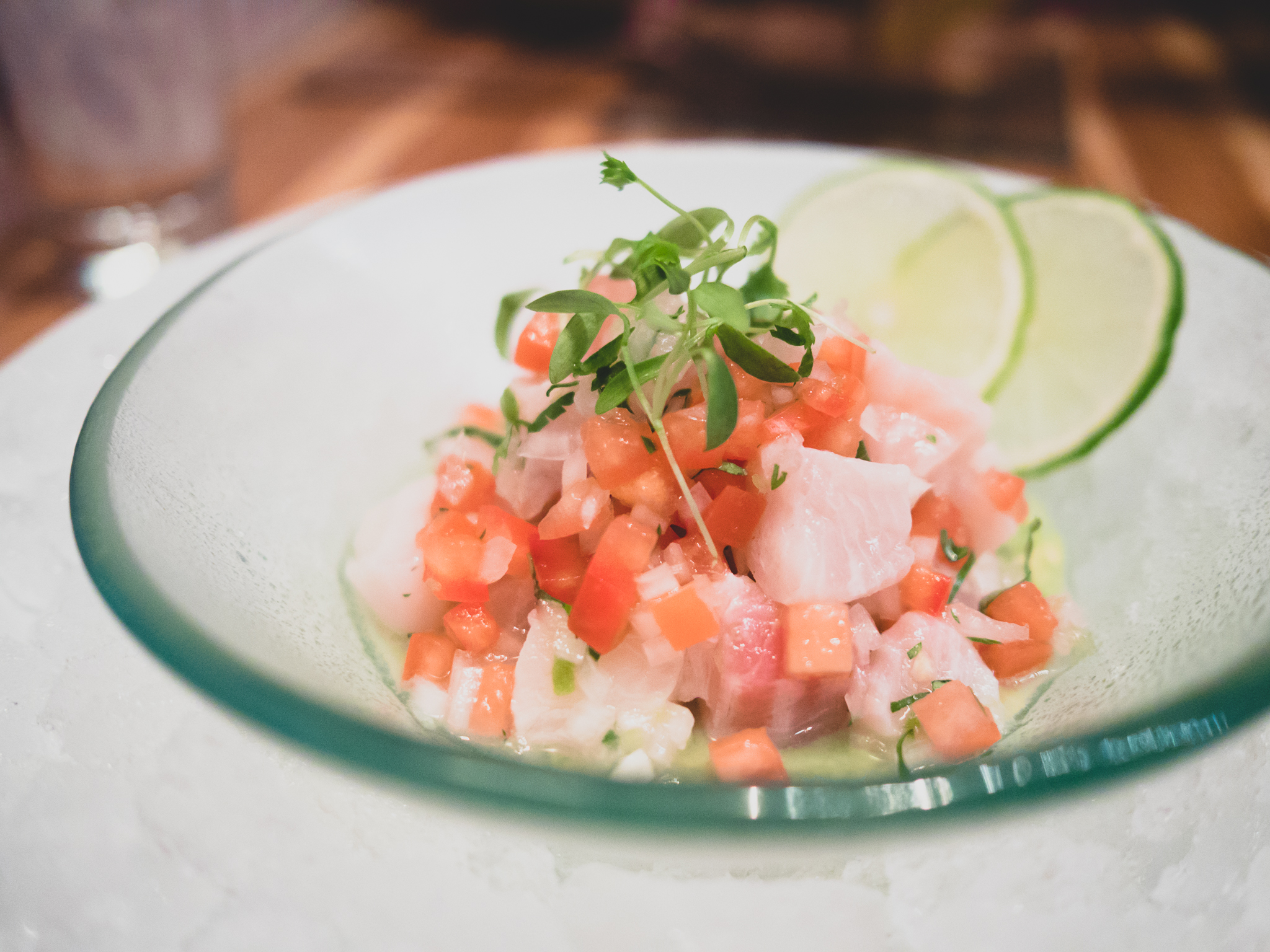ceviche de peje sol : cured sunfish with serrano chiles, tomato, lime.