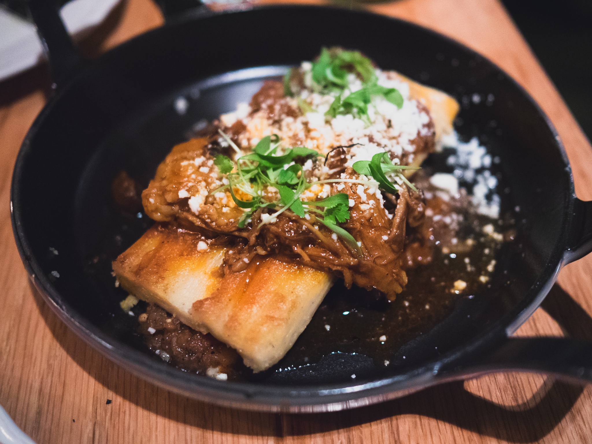 tamale  with lamb neck, king oyster mushroom, queso oaxaca.
