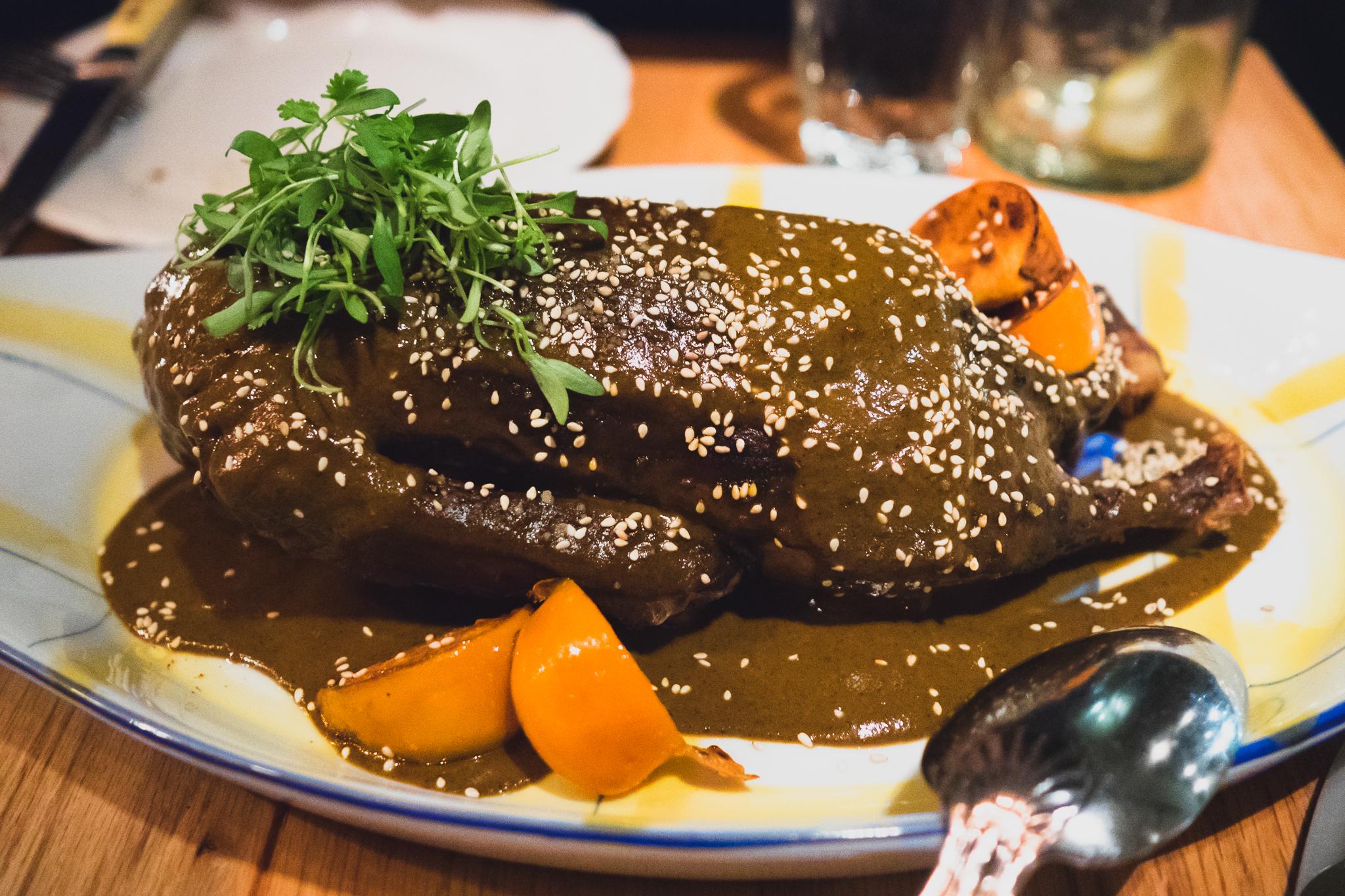 half  duck  with sesame, mole, persimmon.