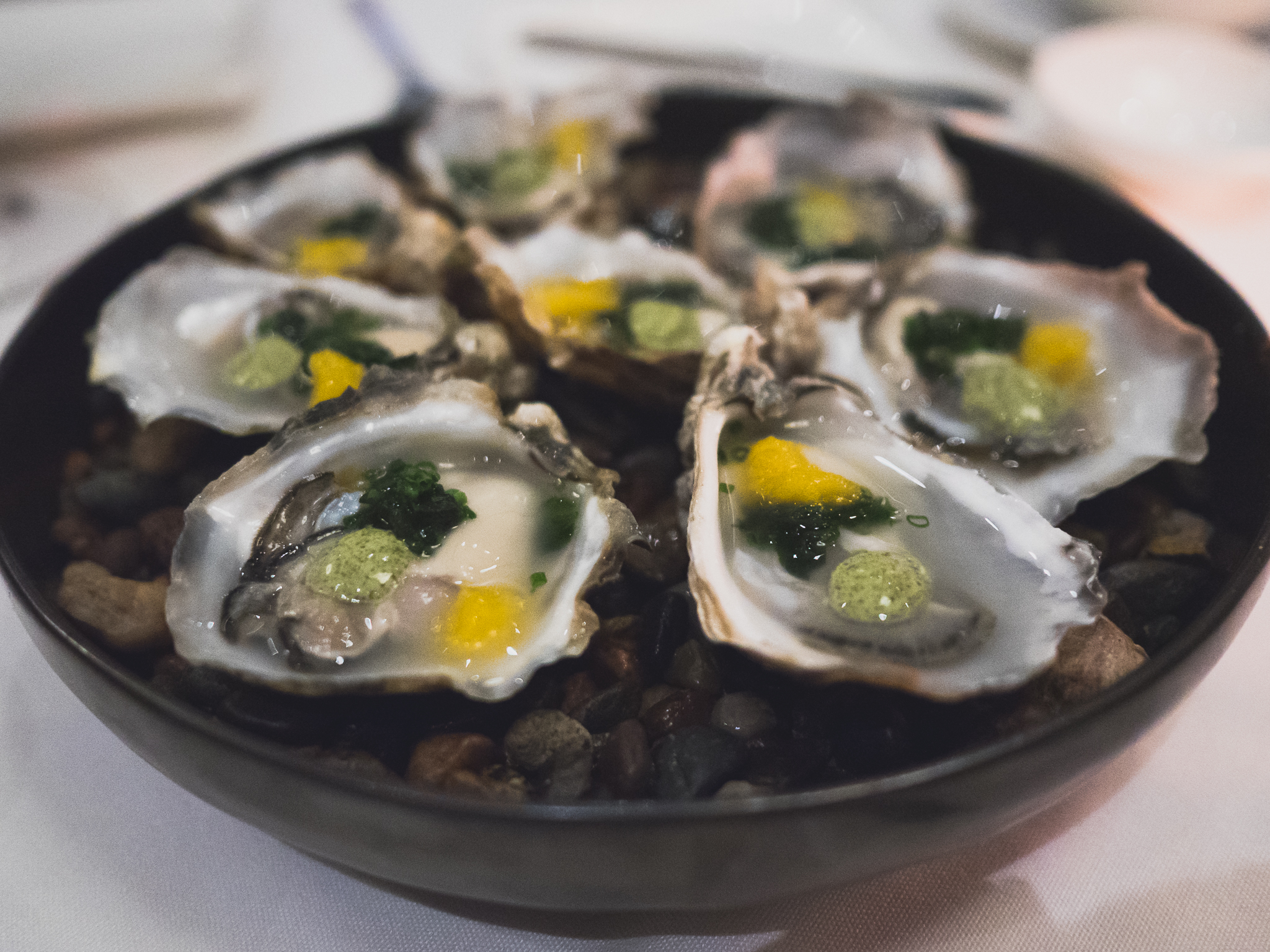 oysters with aji amarillo ice and wakame celery cream.
