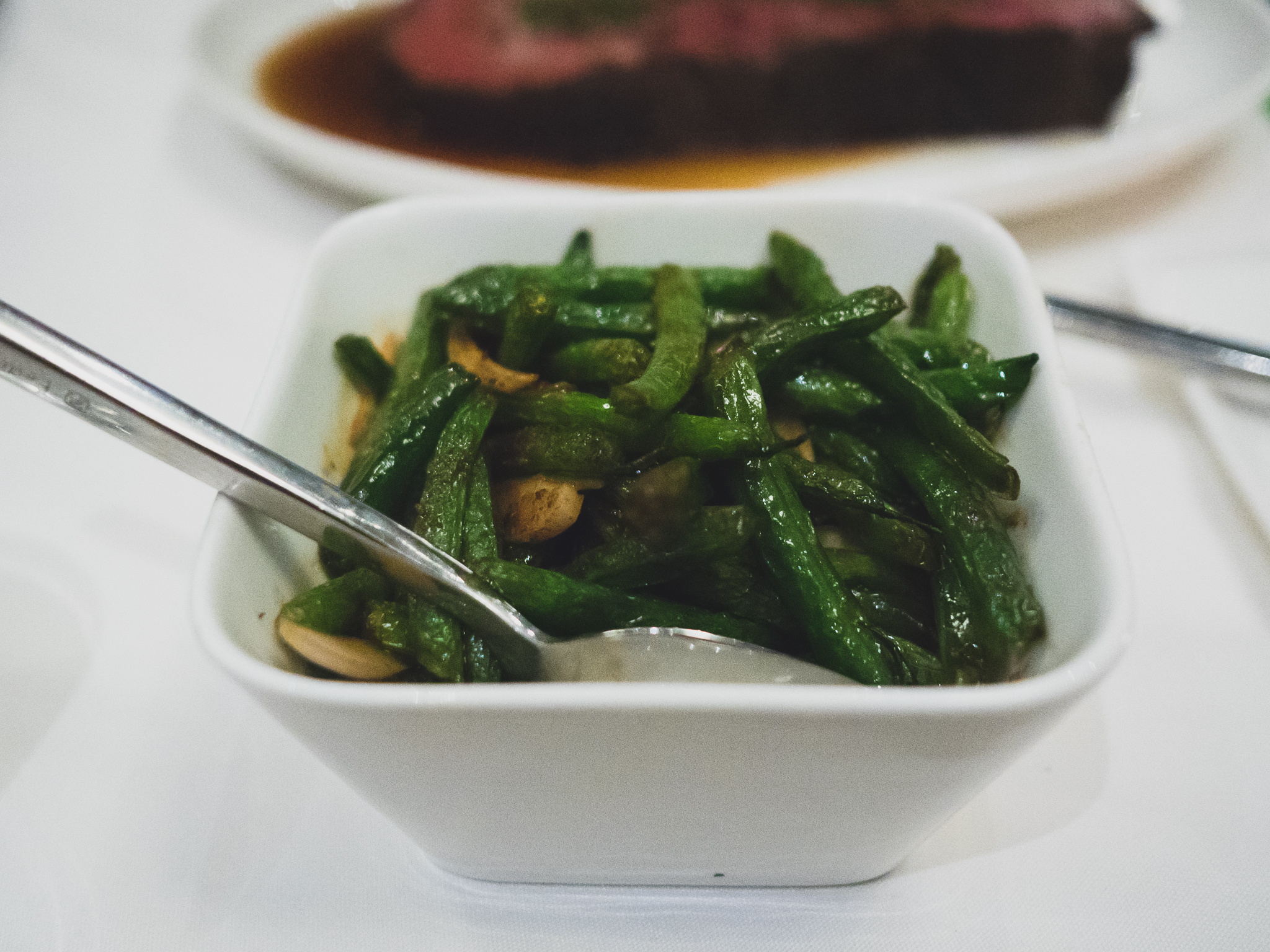 blue lake beans, flash fried, with garlic and sansyo.
