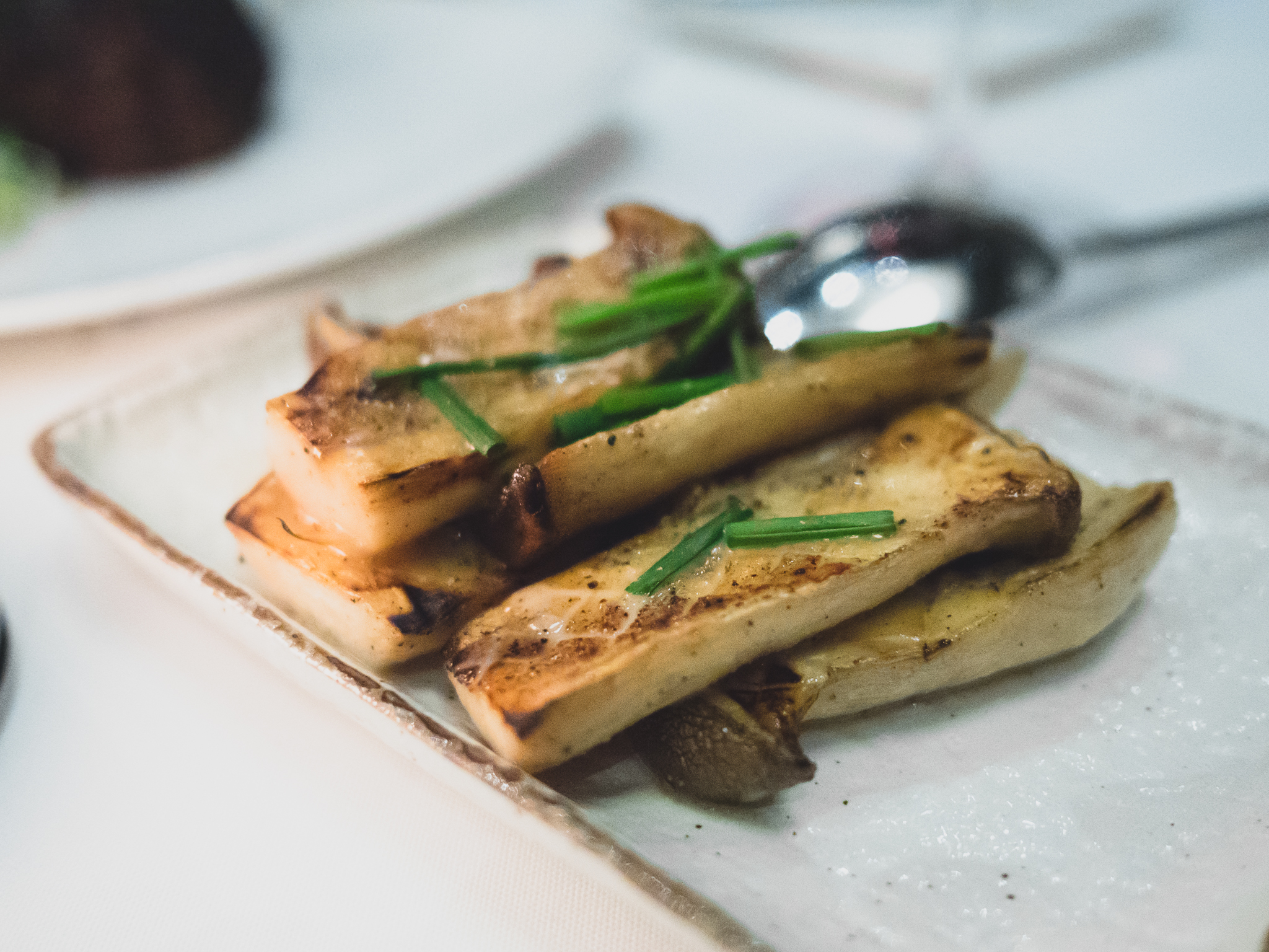 eryngi mushrooms with roasted garlic, thyme and lemon vinaigrette.