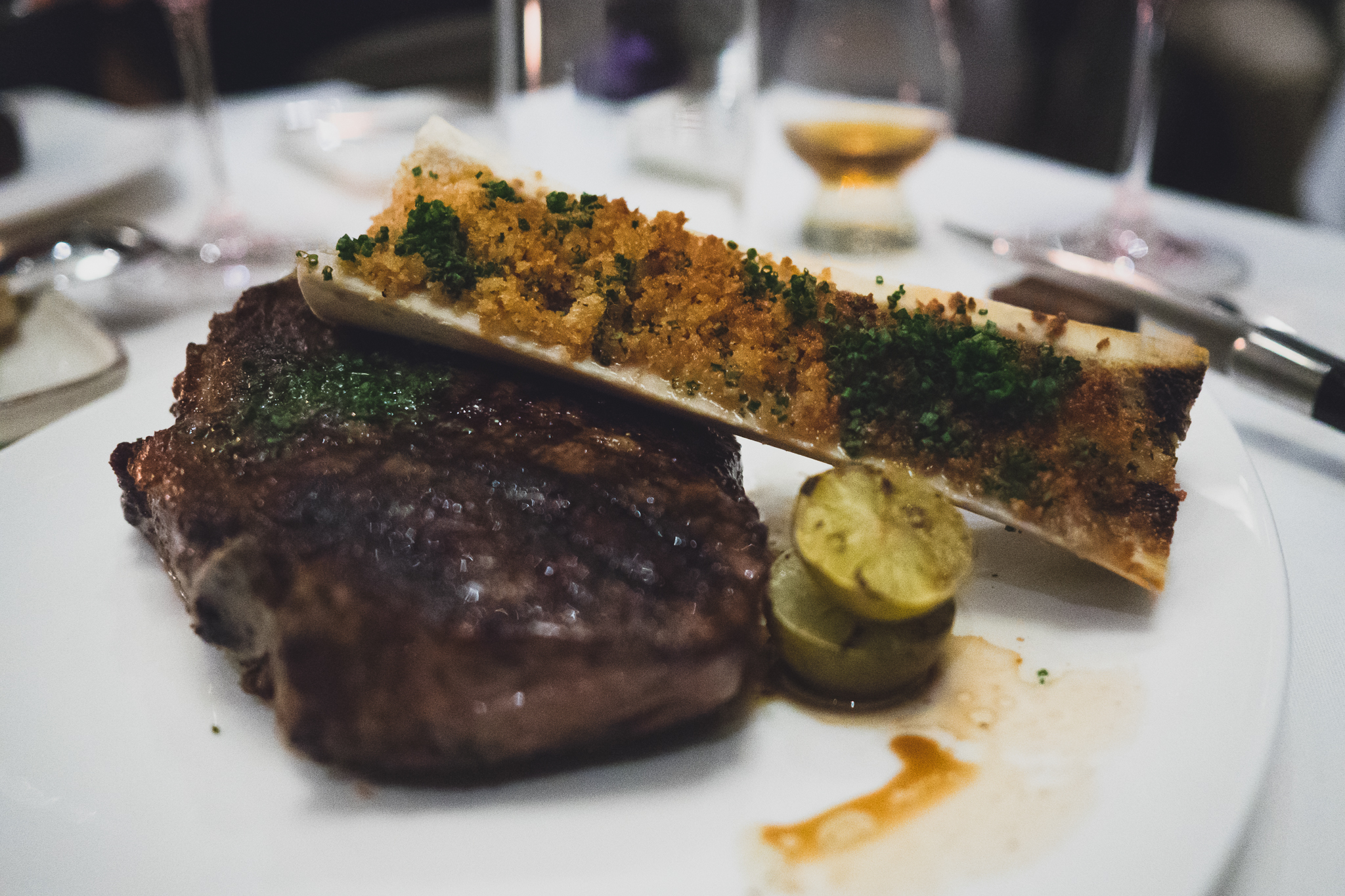 bone in new york with grilled sudachi, chive butter and bone marrow enhancement.
