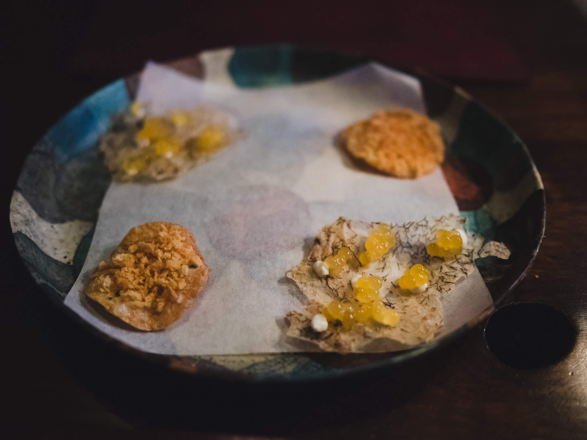 snacks 05. rutabaga and smoked cod roe; 04. oats, trout roe and sea truffle.