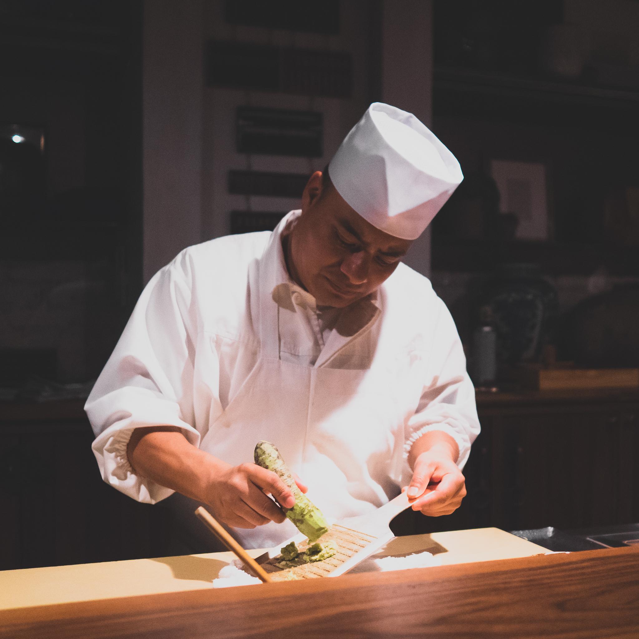 grating fresh wasabi between the tsumami and nigiri sushi courses.