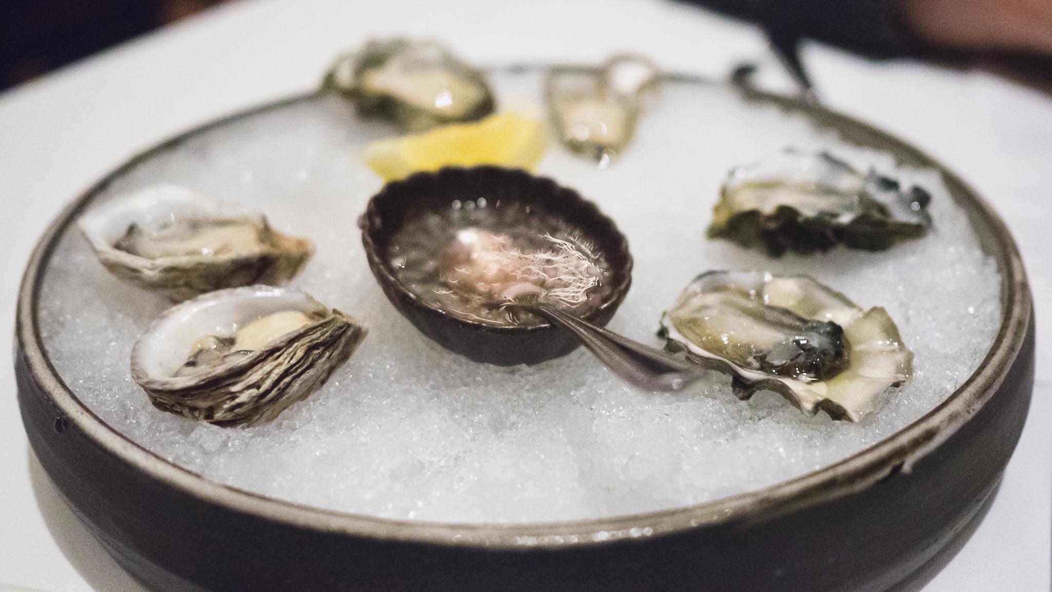 half dozen northwest pacific  oysters .