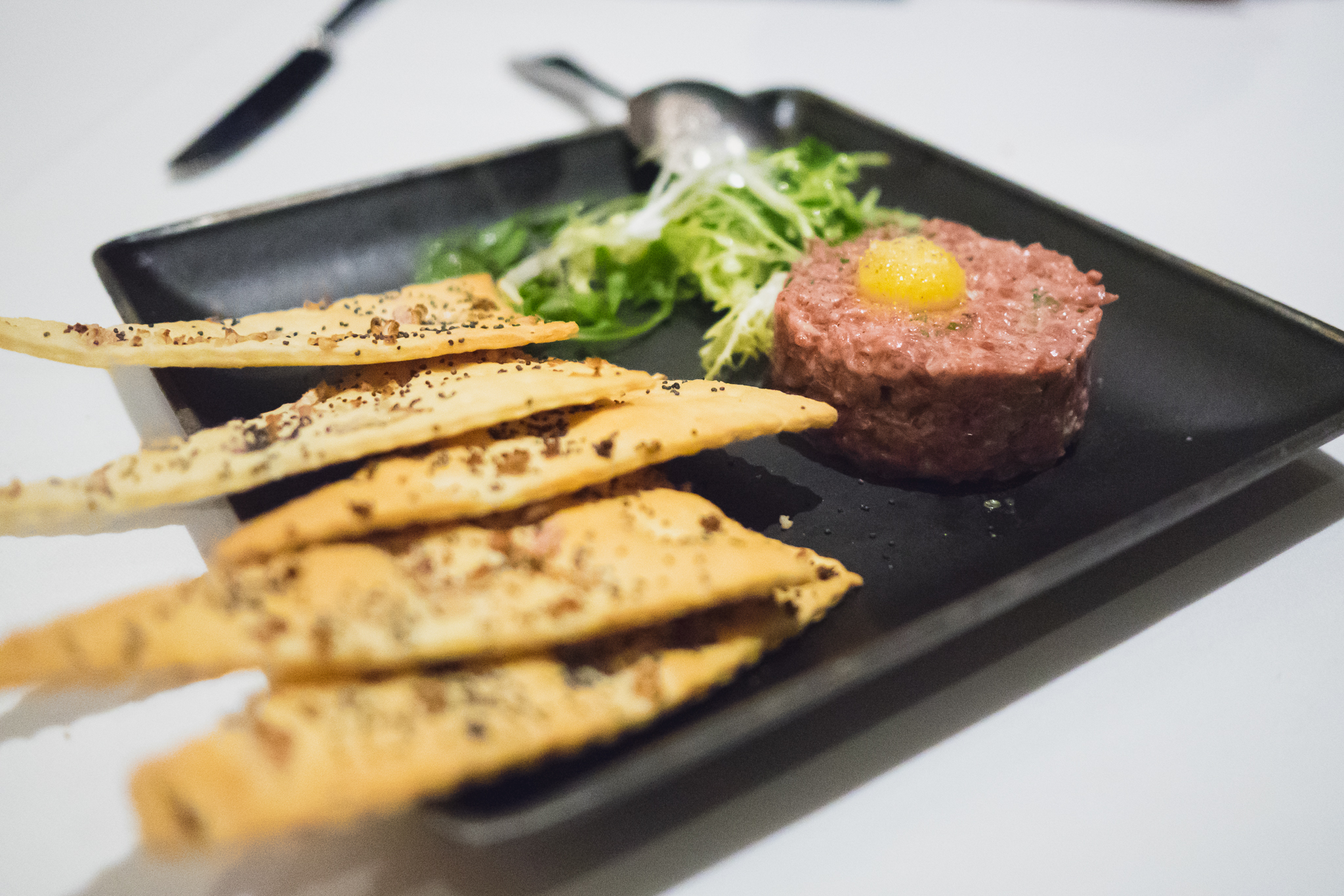 montana wagyu steak tartare  with capers, cornichons, aioli, crackers.