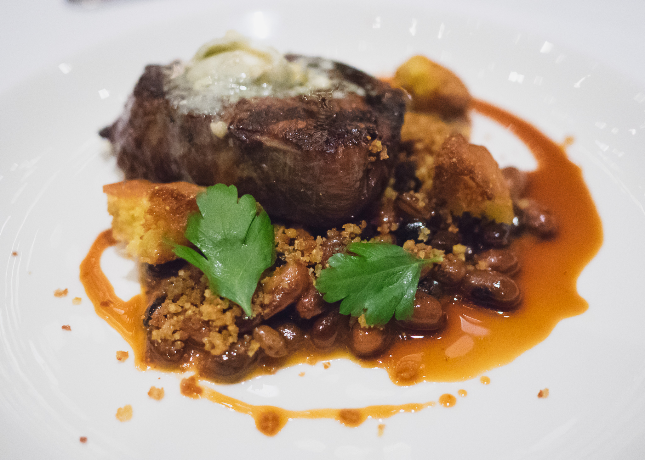 bison tenderloin  with maple bbq rockwell beans, blue cheese, cornbread croutons.