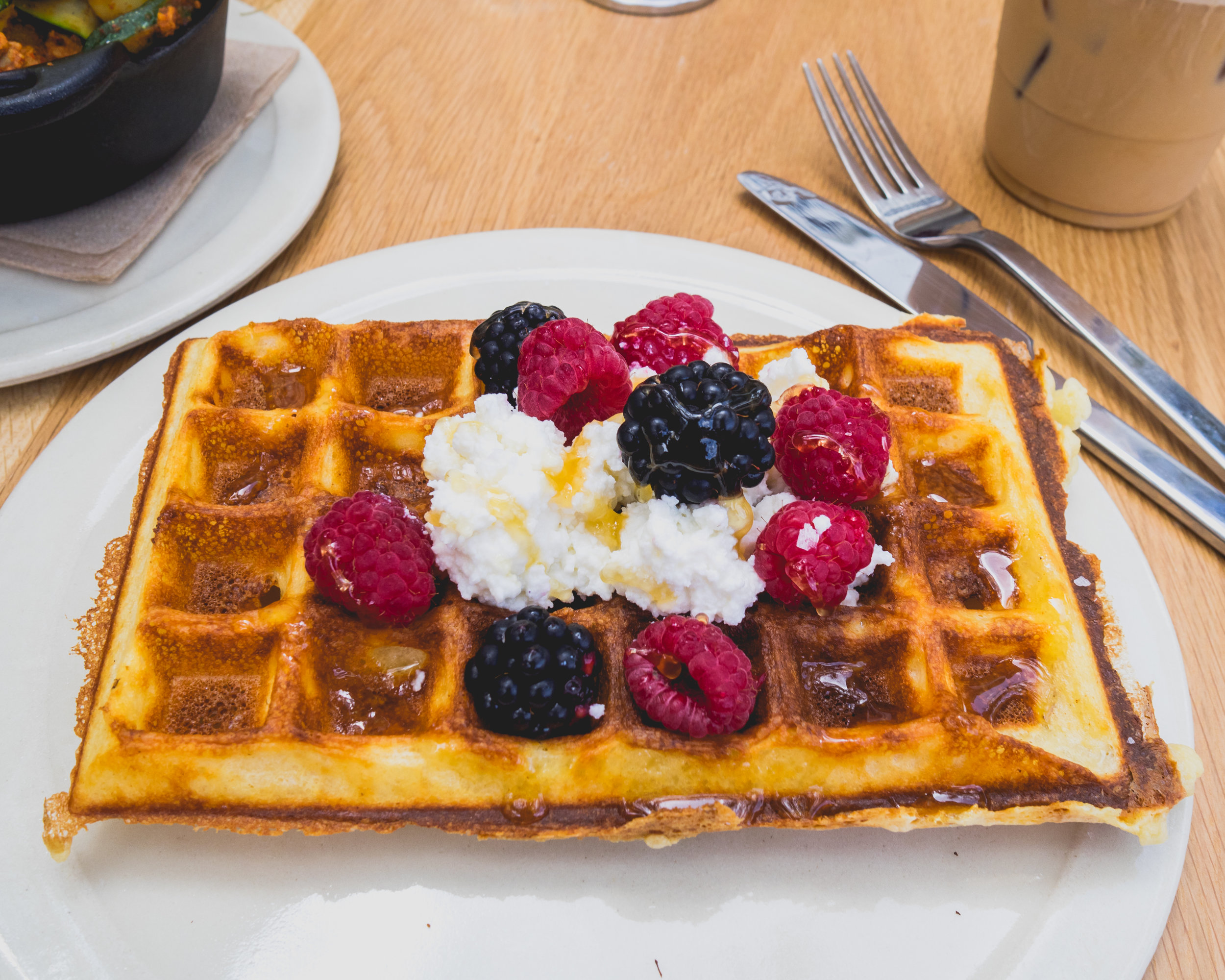 yeast raised waffle  with berries, ricotta, honey.