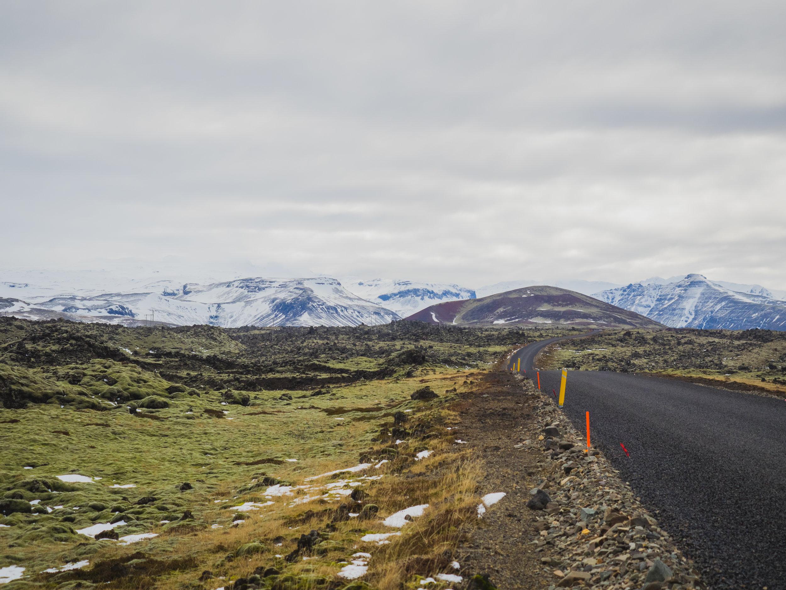 driving along lava fields in snæfellsnes.
