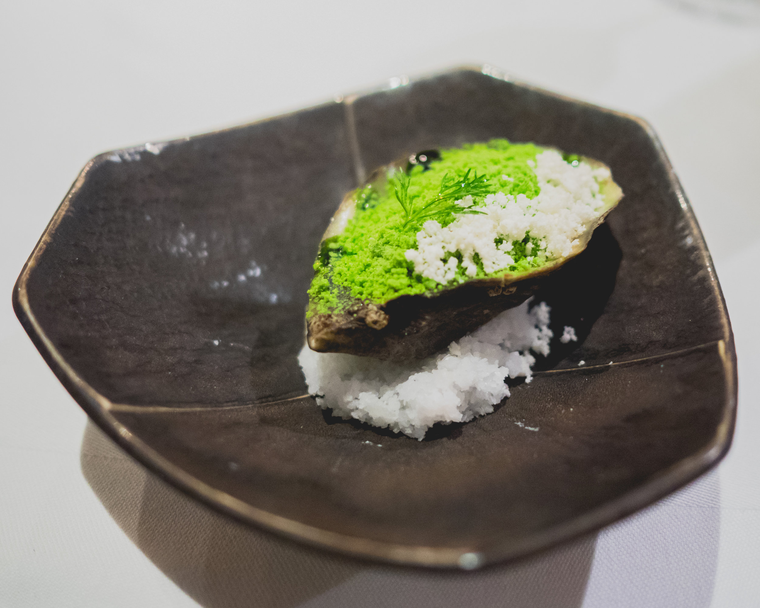 amuse: cold-smoked shigoku oyster, horseradish powder, dill powder, dill oil.
