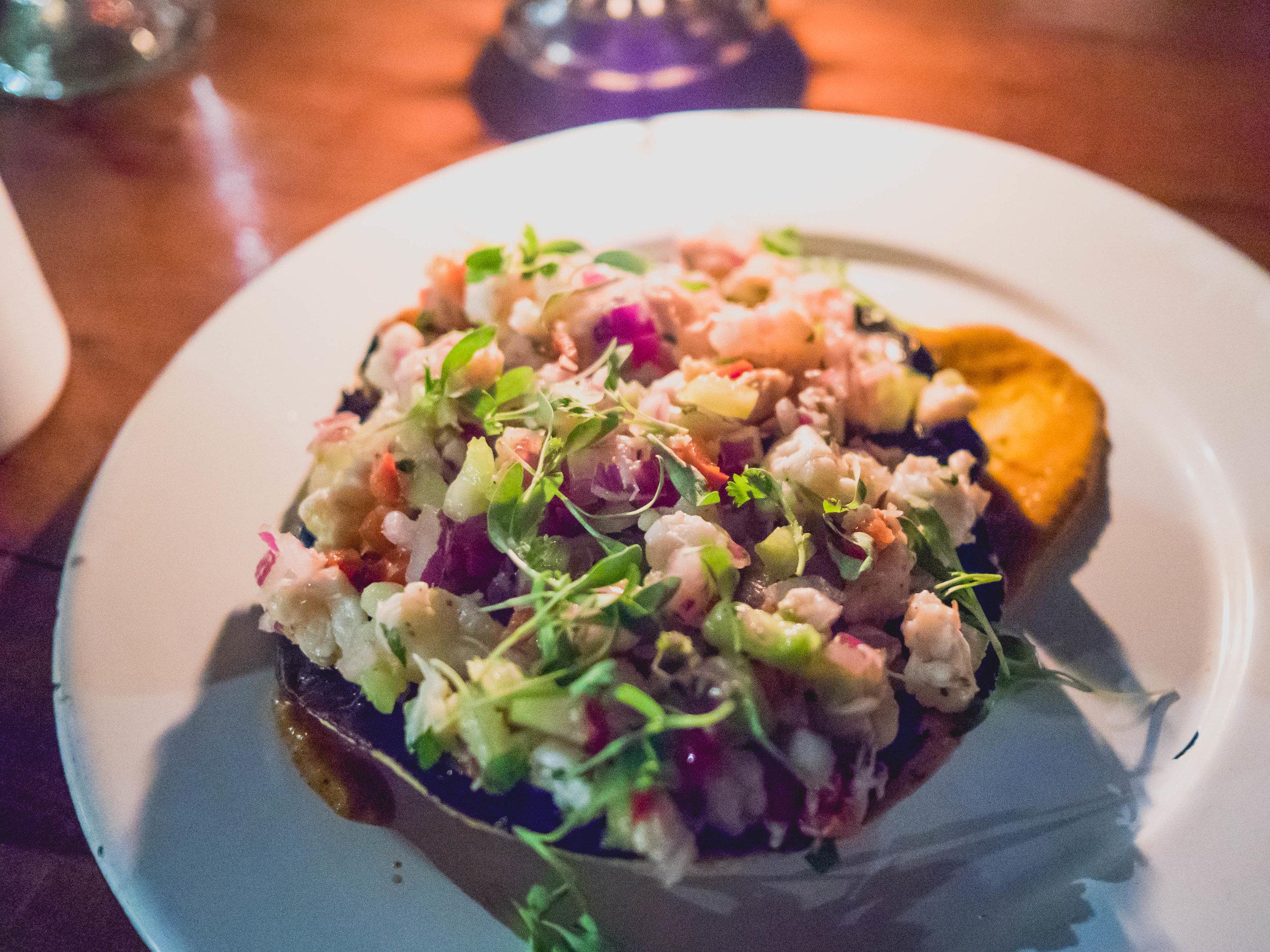 seafood tostada : shrimp, snapper, crab squid ink guacamole.