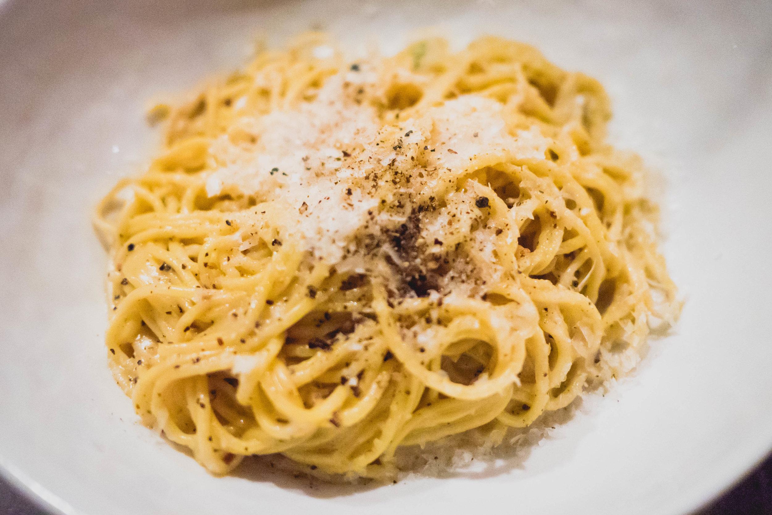 cacio e pepe with cappellini, parmesan brodo, black peppercorn.